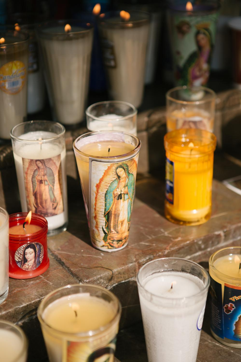 Candles left by visitors sit at the Basilica of Our Lady of Guadalupe in Mexico City, Mexico. Many visitors arrived prior to its closure due to the COVID-19 pandemic.