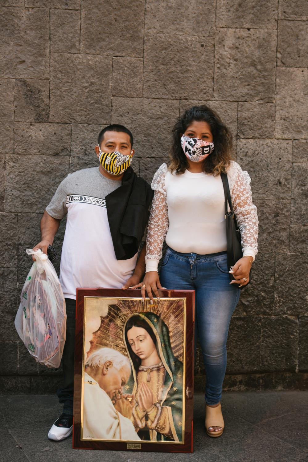 "Bris Angel Sosa Gomez, 35, left, and Leonor Yadira Garcia Mendoza, 27 from Oaxaca, Mexico pose for a portrait at the Basilica of Our Lady of Guadalupe in Mexico City, Mexico. ""Our faith is greater than this illness- that does exist- but we know that before God and before our prayers and supplications [to the Virgin of Guadalupe], she will protect us."" 971 113 48 61 ; dareylliker2019@gmail.com"