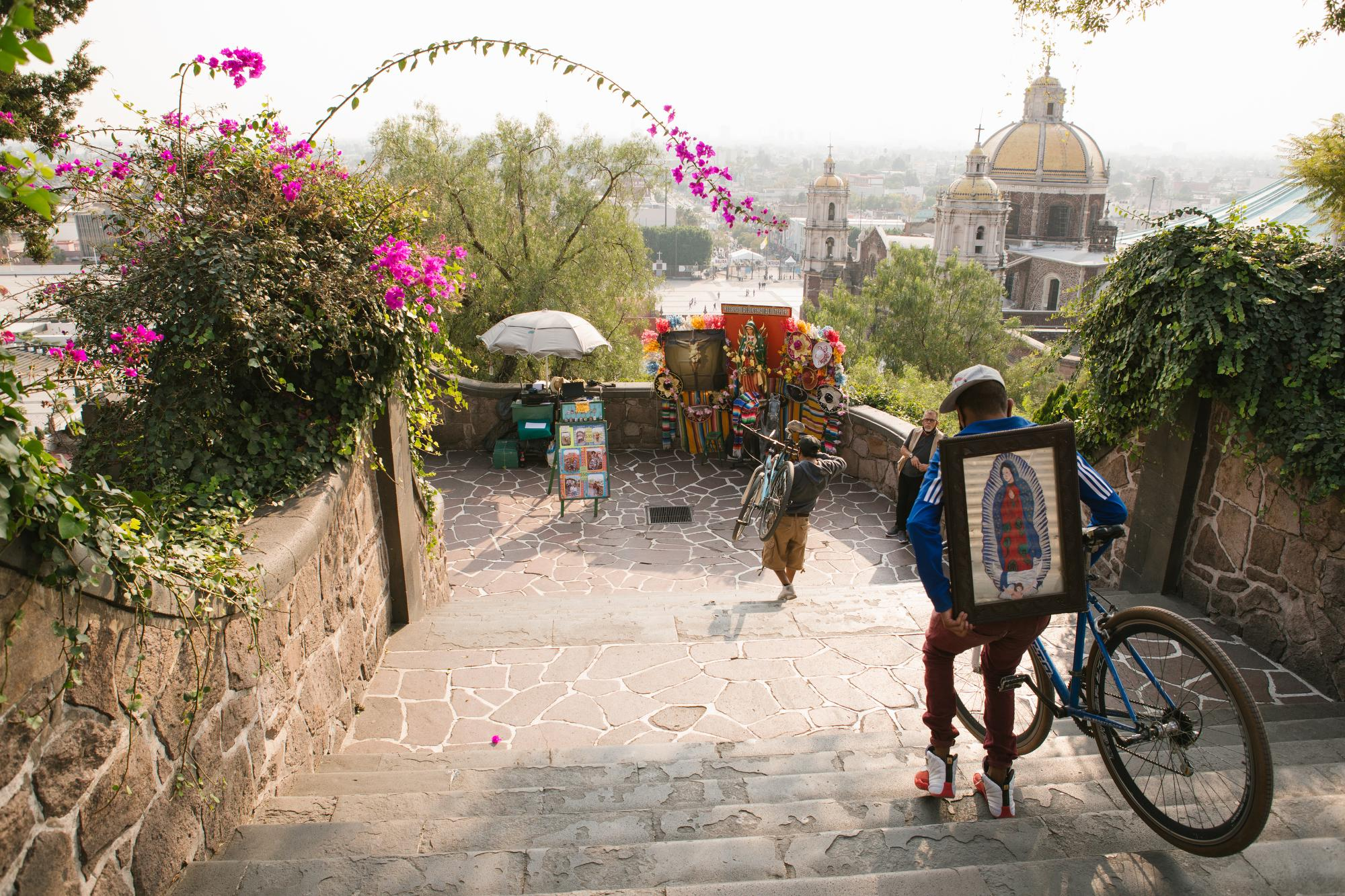 Cyclists carry their bicycles down the Hill of Tepeyac during a visit to the Basilica of Our Lady of Guadalupe in Mexico City, Mexico prior to its closure due to the COVID-19 pandemic.