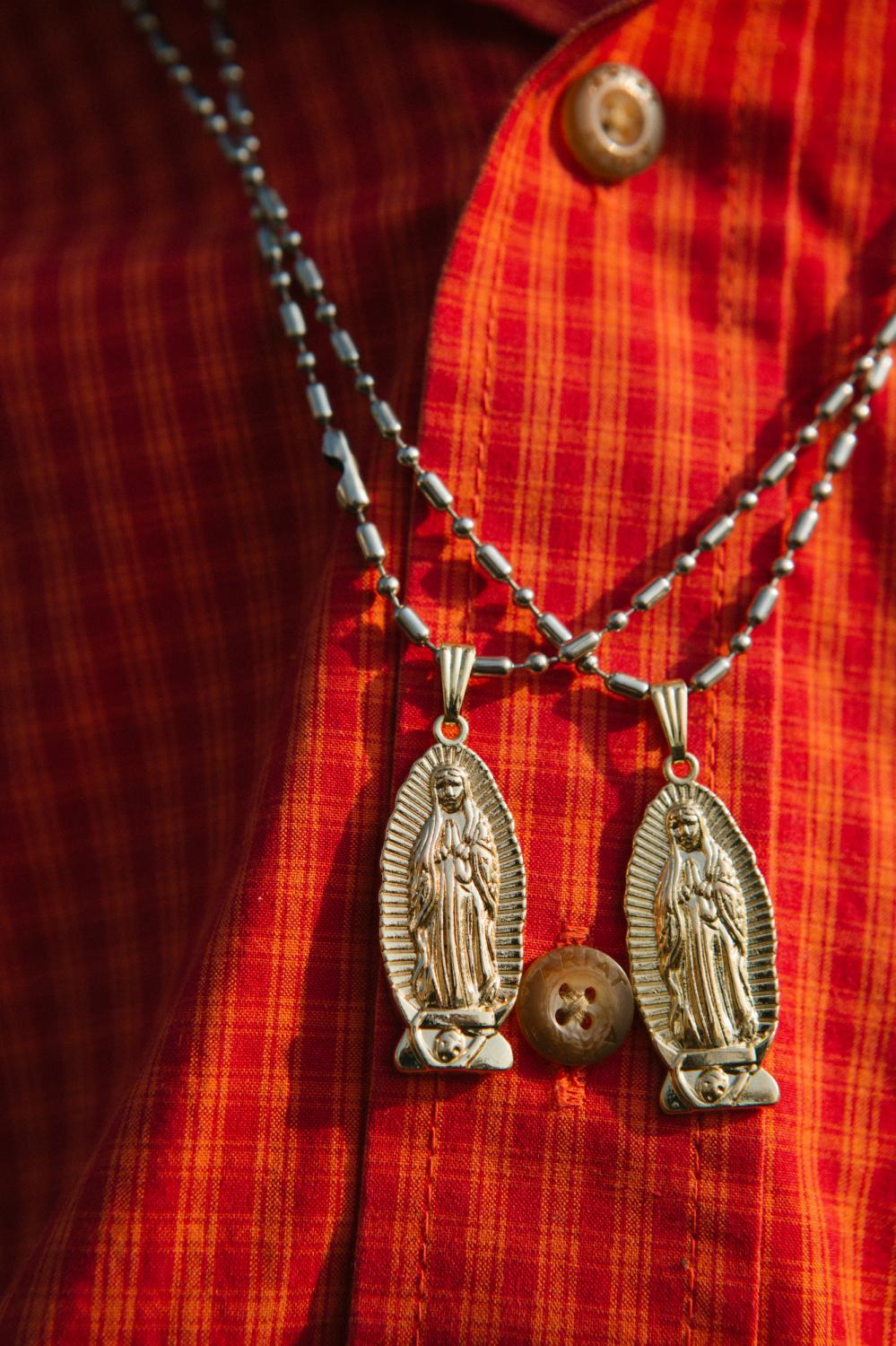 Virgin of Guadalupe necklaces hang from a young man's neck at the Basilica of Our Lady of Guadalupe in Mexico City, Mexico.