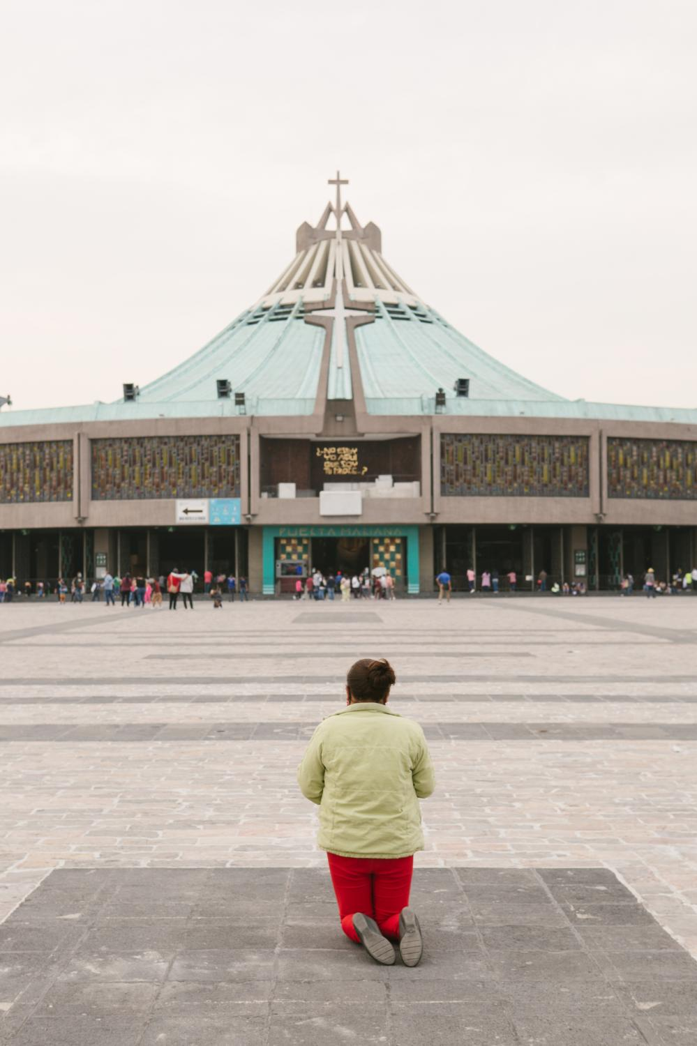 A woman crawls to the Basilica of Our Lady of Guadalupe in Mexico City, Mexico as a symbol of her devotion. Many visitors arrived prior to its closure due to the COVID-19 pandemic.