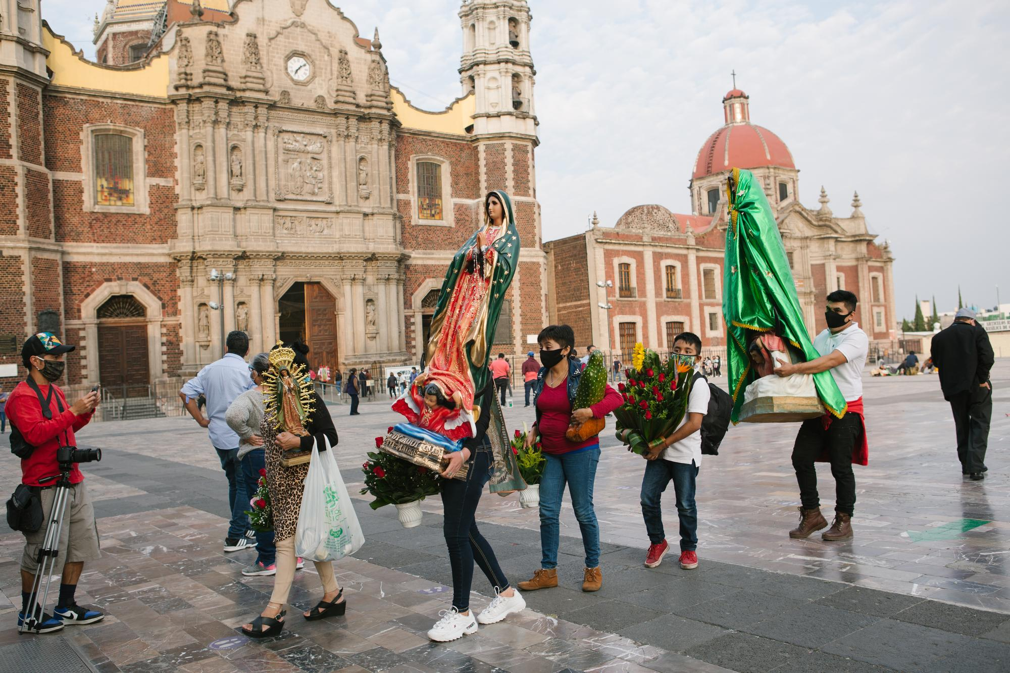 Pilgrims line up for mass at the Basilica of Our Lady of Guadalupe in Mexico City, Mexico. Many visitors arrived prior to its closure due to the COVID-19 pandemic.