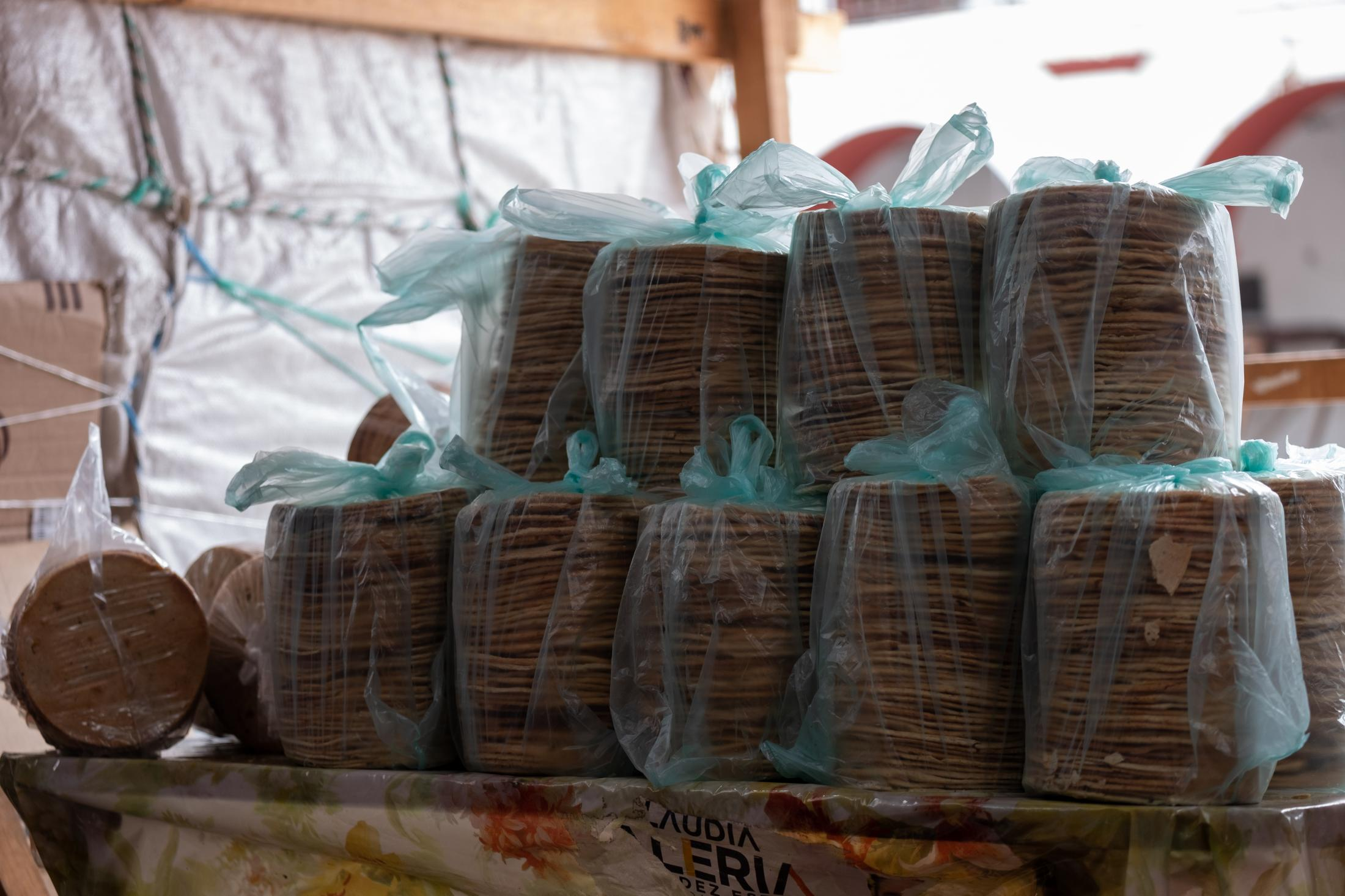 Totopos, a local food that is produced traditionally in Juchitec communities. Totopos have a smoky and sweet flavor with a crunchy texture. Totopos are made in a special way so they can be stored and last longer than regular toasted tortillas. In the markets you can see them packed in stacks like these as they're produced and sold by women from the community.