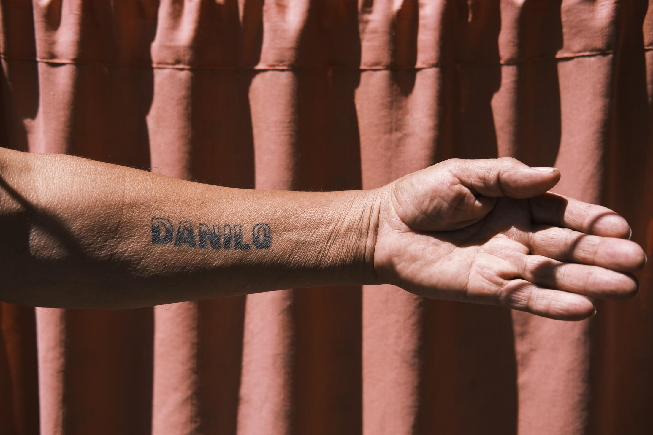 "La Granja, Santiago, Chile, 2020. Juan Cárdenas's tattoo in honor of his son Danilo. ""I was always against marking your own body,"" Juan says. ""But I wanted to remember Danilo every day, so I got a tattoo just like him, for him."""