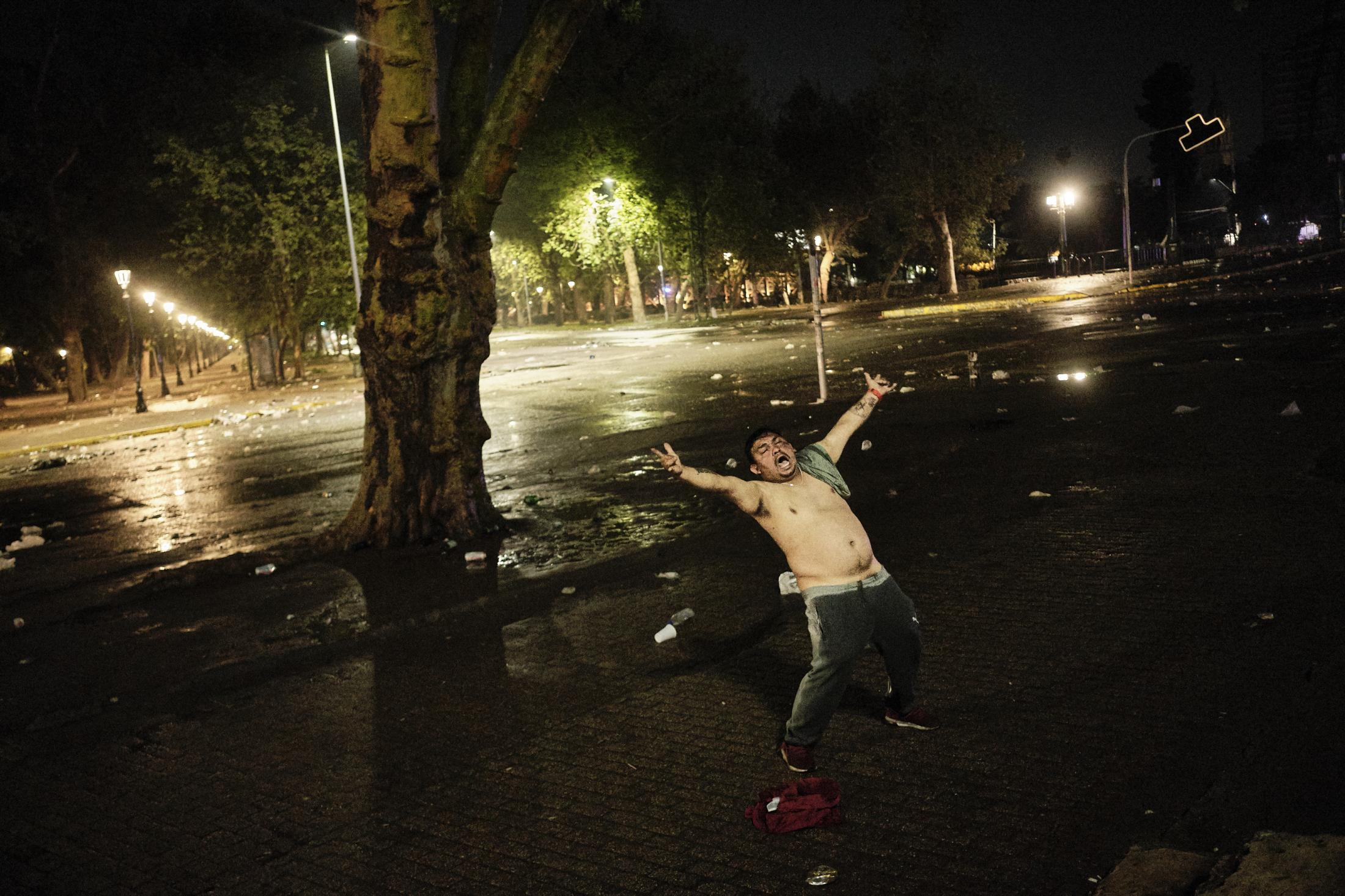 Santiago, Chile, 2020. A man yells alone at Plaza Dignidad after the victory of the referendum to write a new constitution for Chile.