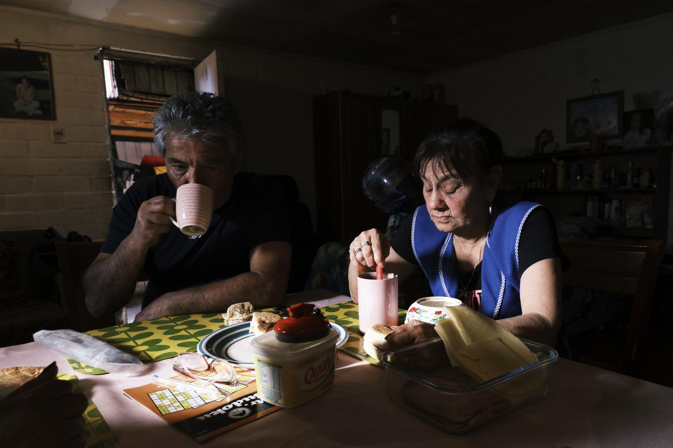 San Bernardo, Santiago, Chile, 2020. Paula Lorca's parents, Ramón and Maria, drink coffee with the family. Just before she died, Paula had dinner at this table with her parents.