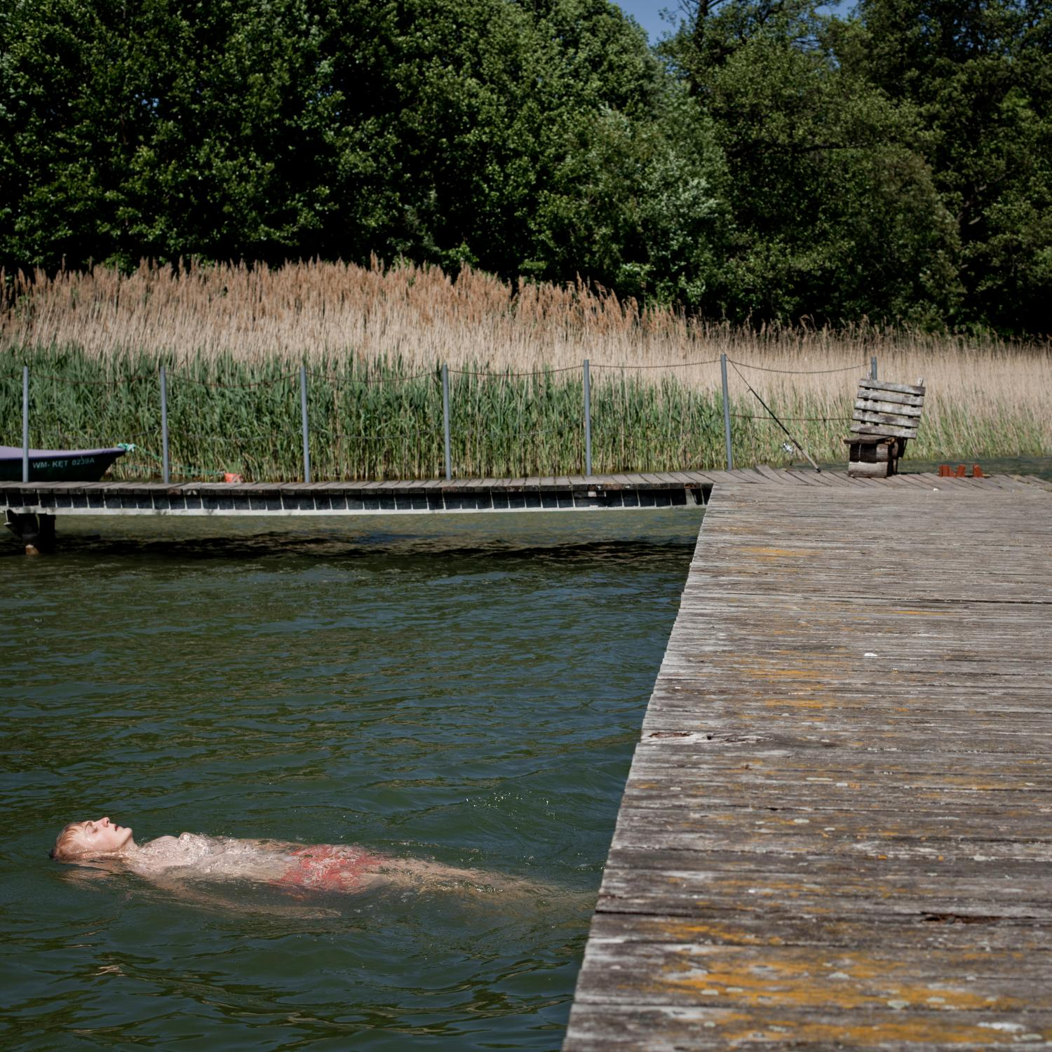 STAWIGUDA, POLAND, JUNE 5, 2015: Ukrainian refugee Pawel is swimming in a lake at the Archdiocesean Charity Centre Caritas where over 130 refugees from the conflict torn Eastern Ukraine; Donetsk and Lugansk regions found temporary shelter. These people were chosen because they have Polish ancestors and have all been flown to Poland in January this year in a special operation of the Polish government. Most of them have been assigned flats in various Polish towns and claim to have found work too, so are preparing to leave this shelter soon. Fot: Piotr Malecki / Panos Pictures