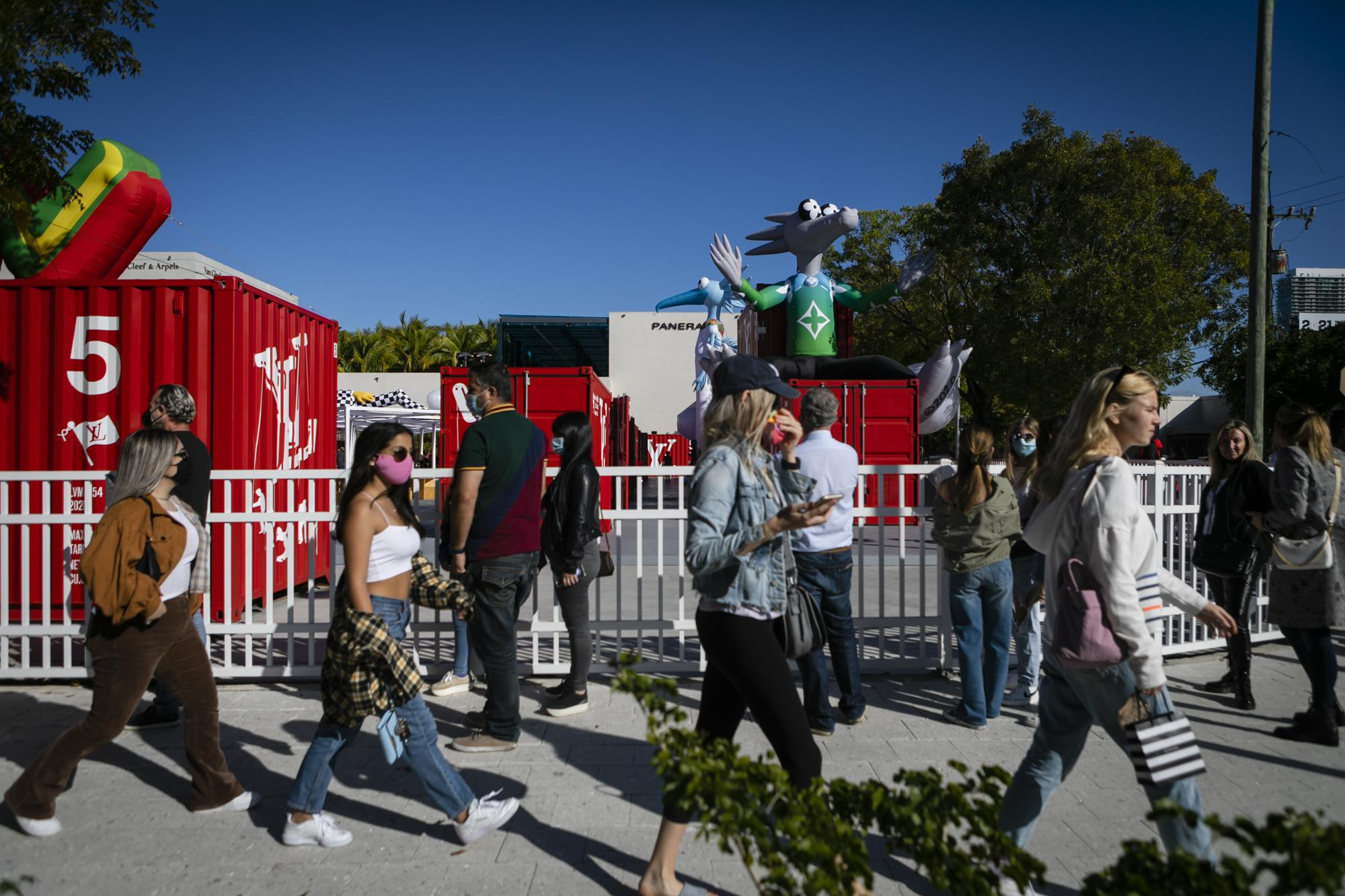 People wait line to visit Louis Vuitton Men's Temporary Residency exhibition, in Miami, Florida on January 09, 2021. Eva Marie UZCATEGUI