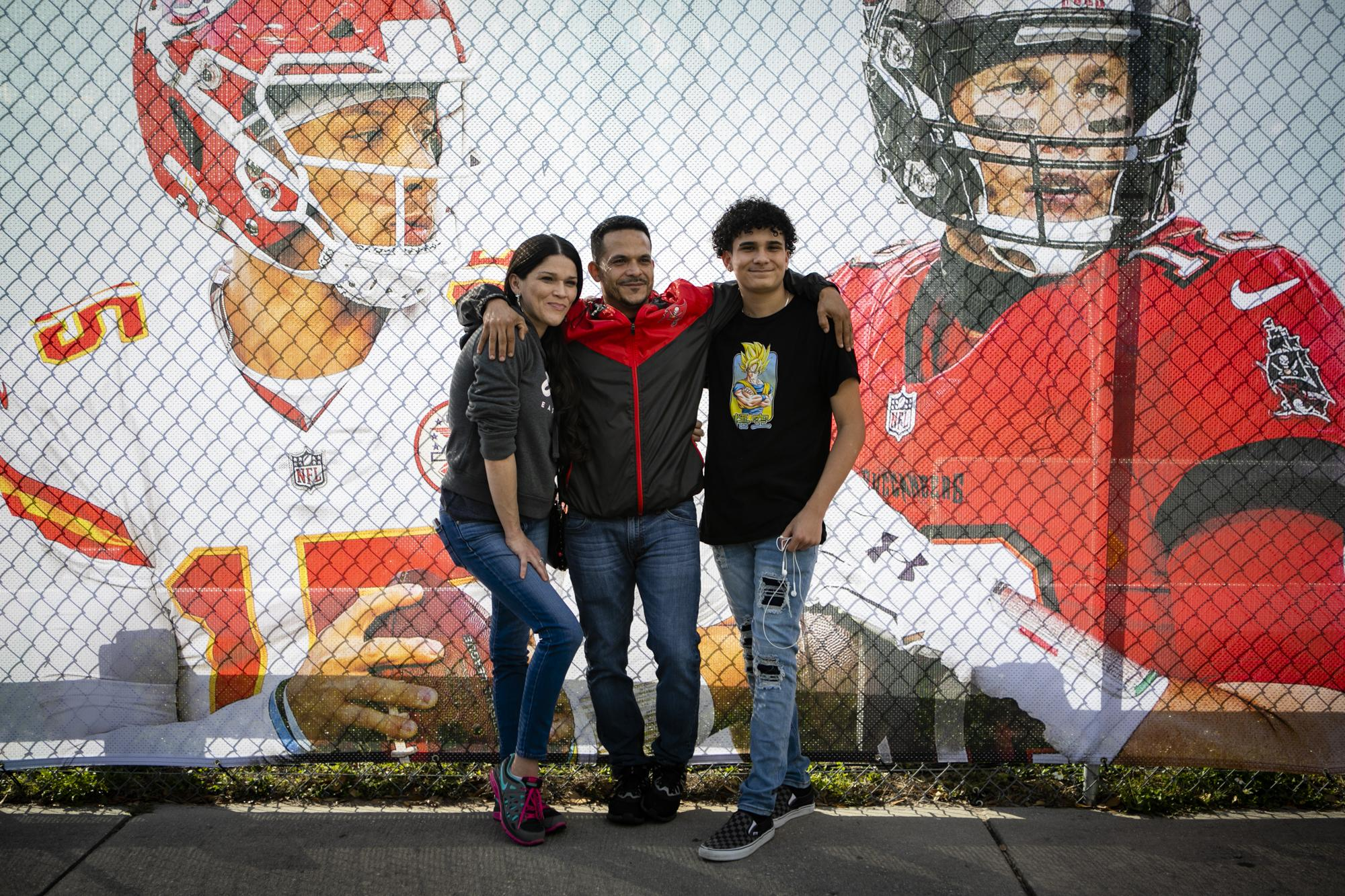 FLORIDA, USA - FEBRUARY 06: Fans pose for a photo outside Raymond James Stadium a day before the Super Bowl LV, in Tampa, Florida, United States on February 06, 2021.