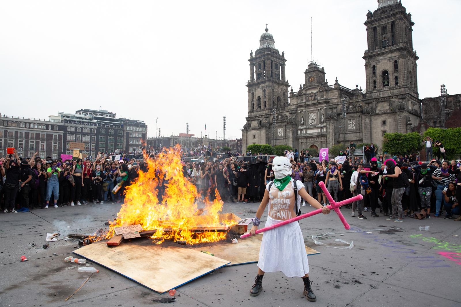 MEXICO Demonstrators circle round a wood pile they set on fire as they rally against gender-based violence and inequality on International Women's Day in Mexico City on March 8, 2020. According to government statistics, at least ten women are murdered every day in Mexico, making it one of the most dangerous countries in the world for girls and women.