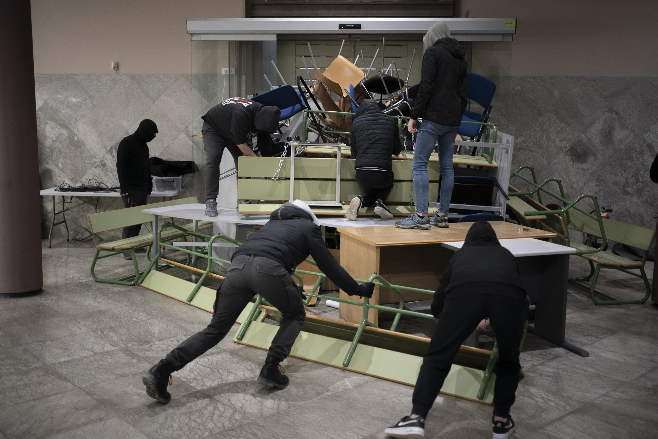 upporters of rap singer Pablo Hasel make barricades inside the University of Lleida, Spain, Monday, Feb. 15, 2021. The imprisonment of Pablo Hasel for inciting terrorism and refusing to pay a fine after having insulted the country's monarch has triggered a social debate and street protests. (AP Photo/Joan Mateu)