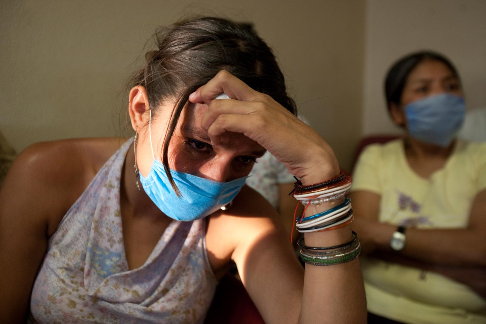 MEXICO A Mexican woman experiencing swine flu-like symptoms sits in an emergency room of the General Hospital in the Iztapalapa borough of Mexico City on April 28, 2009. She waited four hours before she could beexamined by a doctor.