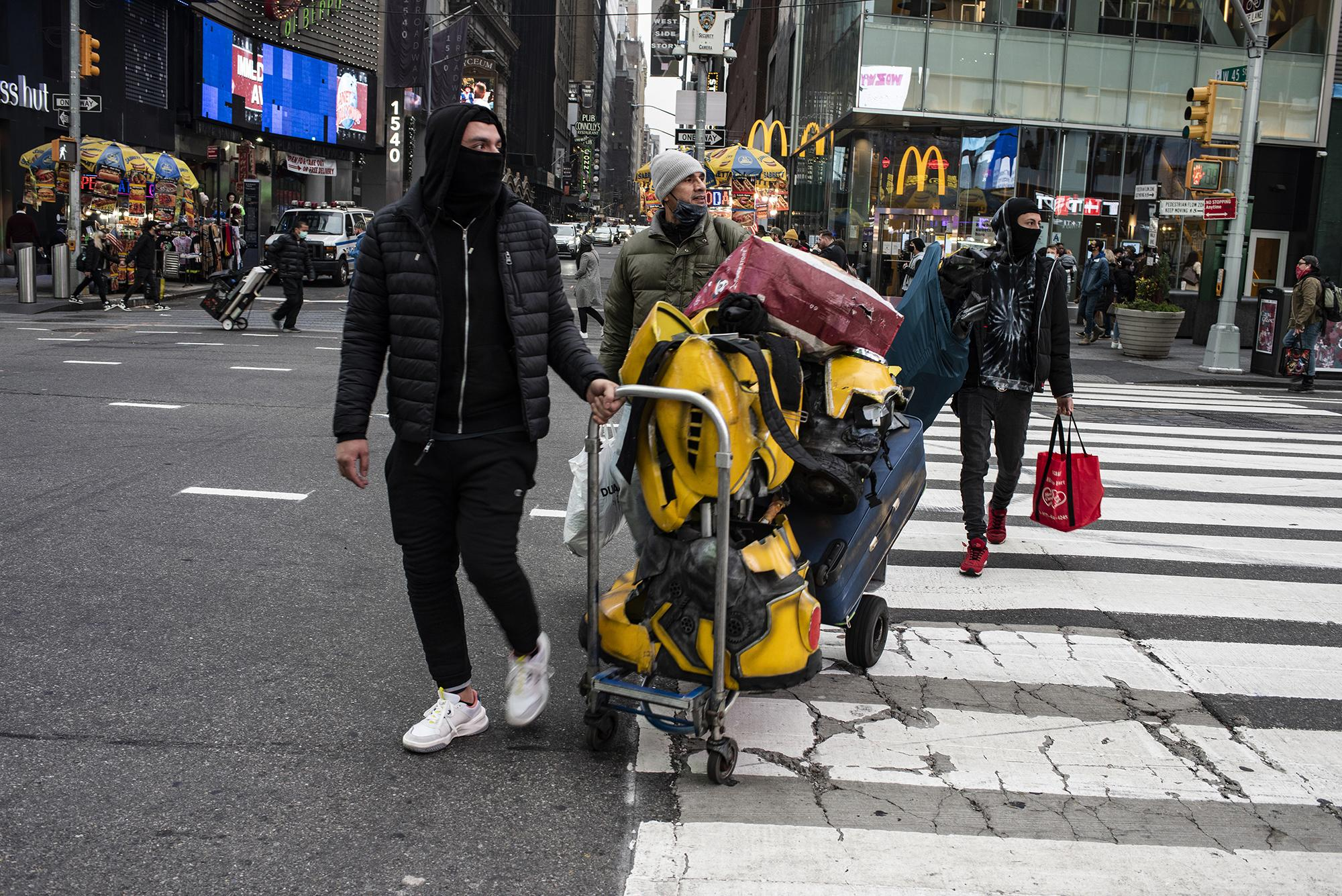 A group of street performers get ready for work in Times Square. December 13, 2020