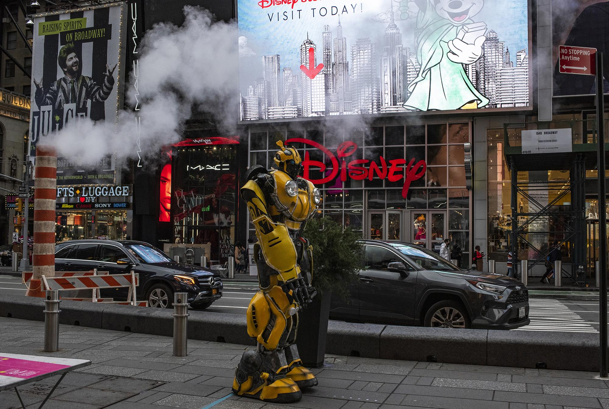 Street performer in a Transformer costume waits for tourist in an empty Times Square. October 31, 2020