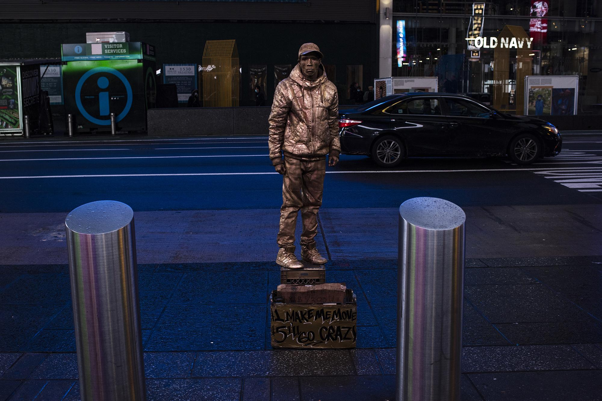 A street performance posing as a sculpture in the empty streets of Times Square on Octubre 31, 2020 in New York City.