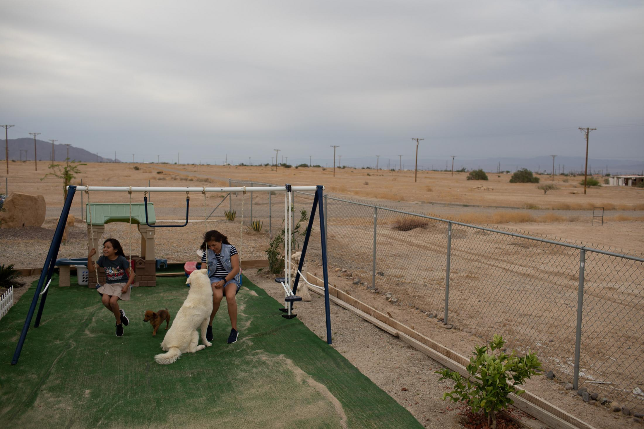 """Lizzette and her mum are playing after schools, at the family back yard, near Salton City. Her mum Miriam Juarez """" Our kids are chronically ill, the toxic dust is of course affecting us"""" as strong winds are whipping up dust."""