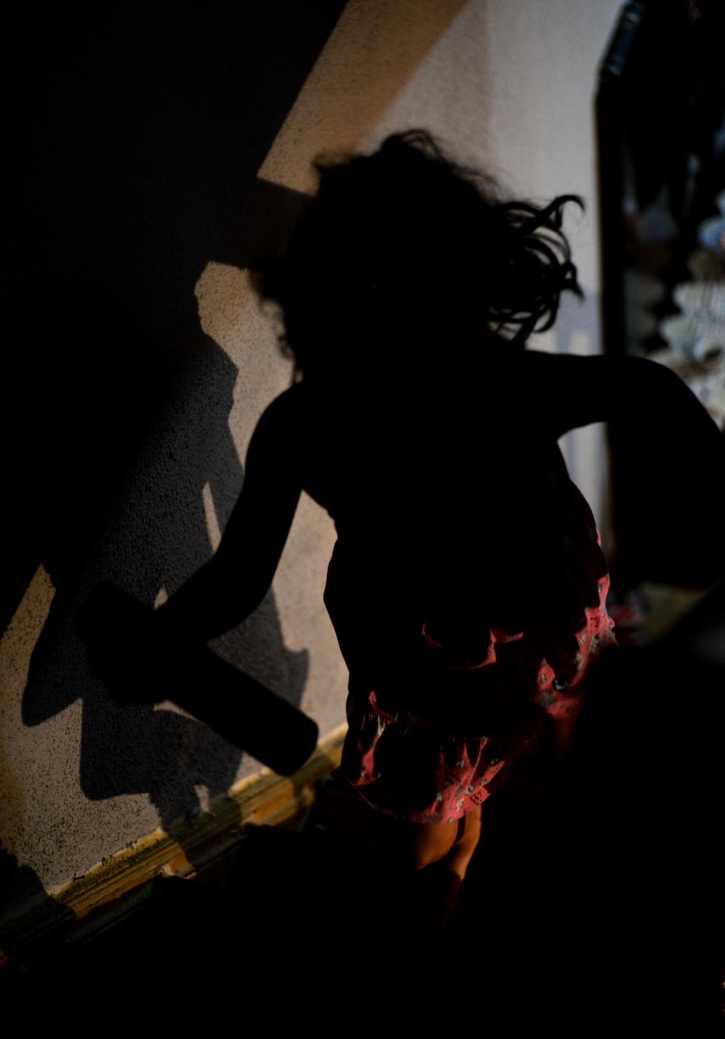 Lamar Ibrahim, 8, runs up the stairs to grab toys on Tuesday, Dec. 1, 2020, in Santo Andre, Sao Paulo State, Brazil. Lamar and her sister Celin Ibrahim, 7, were asked by their mother, Rama AlOmari, to clean their toy room after finishing playing.