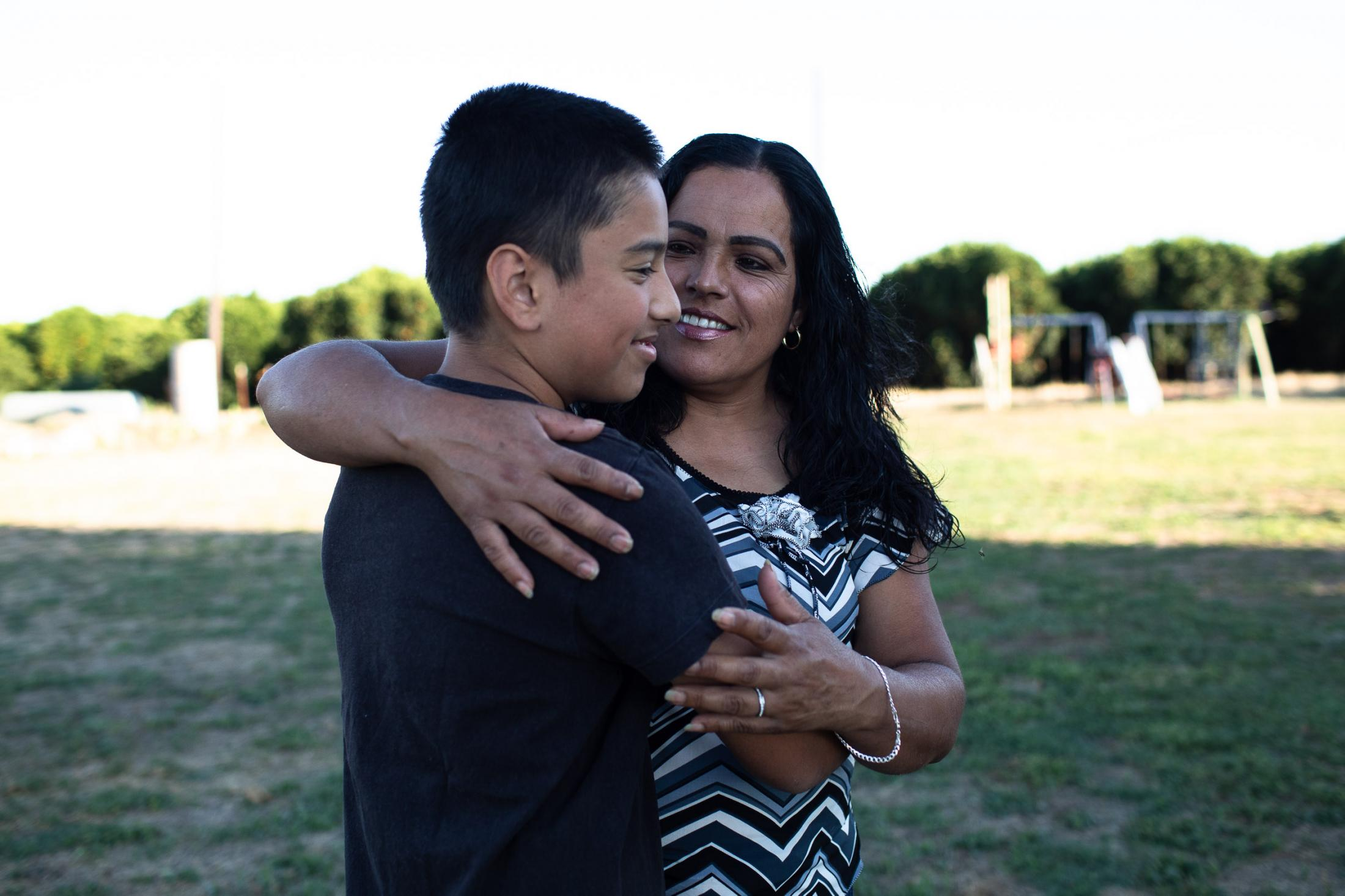 Fidelia Morales hugging her son Junior in their backyard that is surrounded by orange tress on all sides. c hlorpyrifos is a neurotoxic pesticide widely used in U.S. agriculture to kill agricultural pests. It is associated with neurodevelopmental harms in children. In October 2019, the state announced that under an enforceable agreement with manufacturers, all sales of chlorpyrifos to California growers would end by Feb. 6, 2020,
