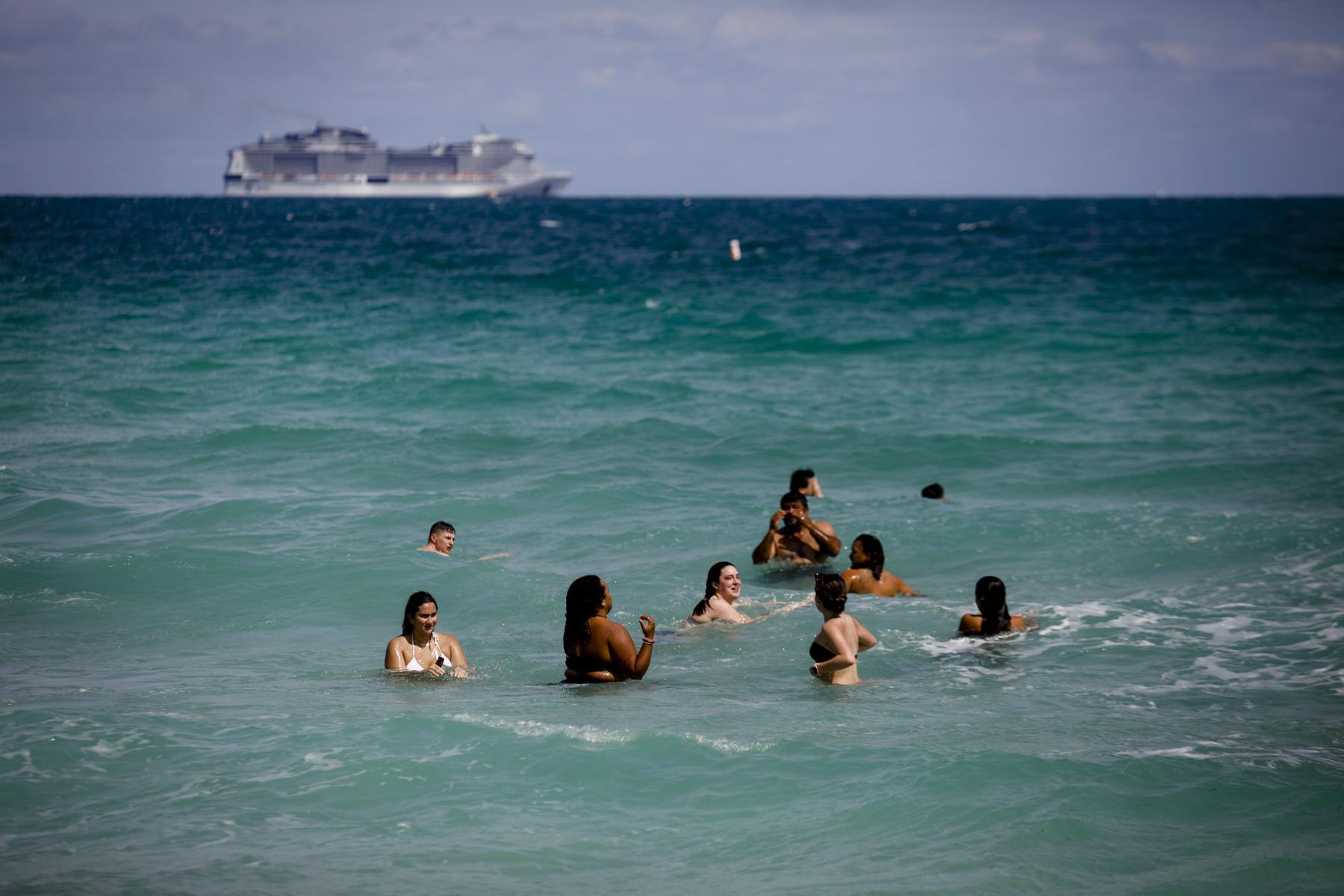 People bath in the beach during Spring Break in Miami Beach, Florida, U.S., on Saturday, March 6, 2021. Photographer: Eva Marie Uzcategui/Bloomberg