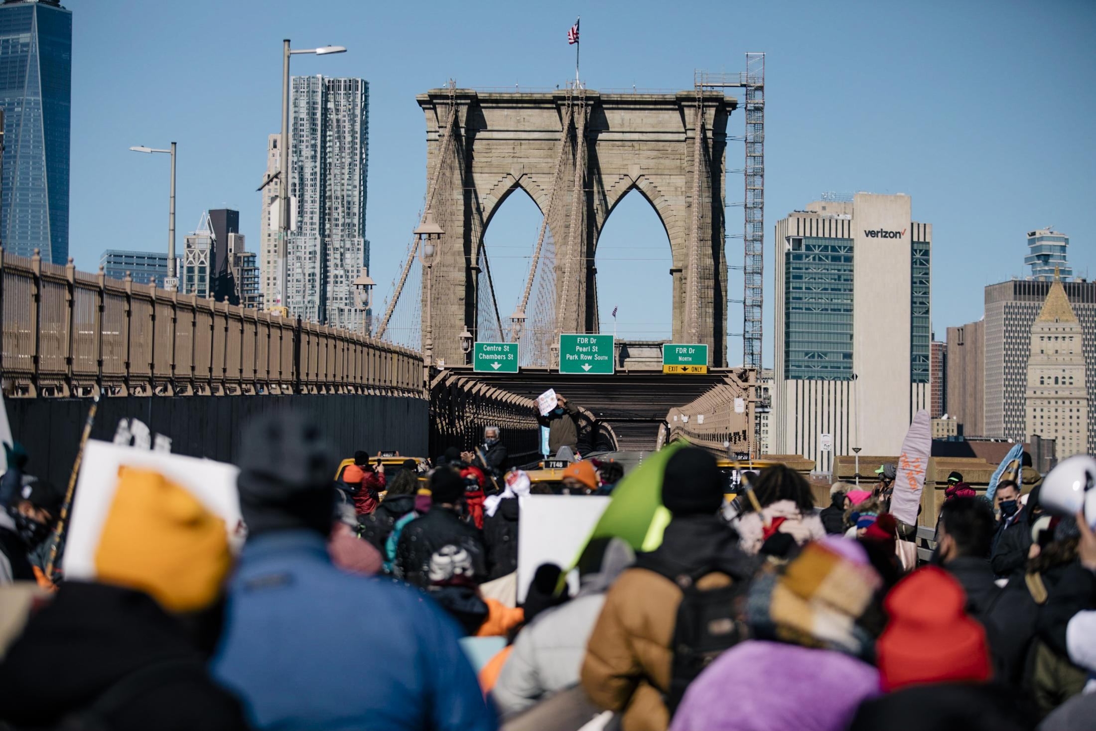 New York City, New York — March 5, 2021: Hundreds of marchers, consisting of undocumented workers from all workforces, navigate across the Brooklyn and Manhattan Bridge to demand unemployment benefits and funding for excluded workers in New York State budget. CREDIT: José A. Alvarado Jr. for The New York Times