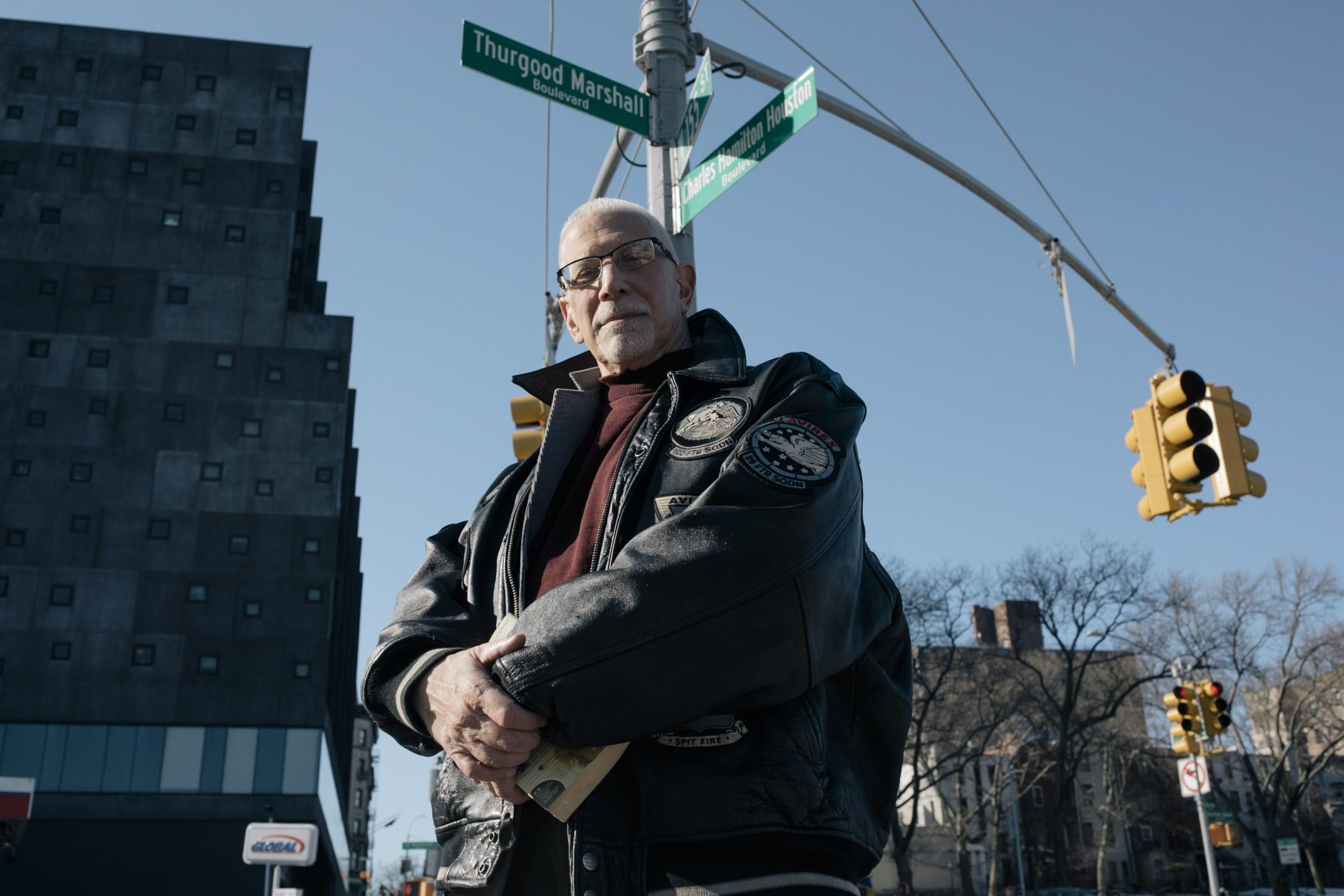 New York City, New York — February 21, 2021: As the sun rises over Harlem, Jacob Morris, director of the Harlem Historical Society, stands on the corner of Edgecombe Avenue and W 155th Street, which was renamed Thurgood Marshall Boulevard and Charles Hamilton Houston Boulevard and enjoys a crisp February afternoon in the historical Harlem neighborhood of Sugar Hill. CREDIT: José A. Alvarado Jr. for The New York Times