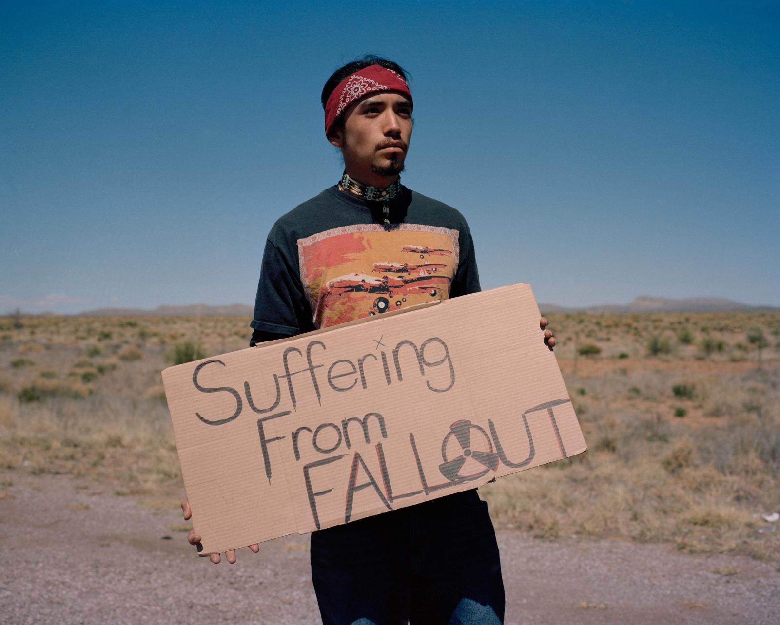 Jacob Olascoaga, White Sands Missile Range, New Mexico, USA, April 2, 2016  Jacob Olascoaga, 21 years old from Tularosa / Mescalera protests outside the entrance to the Stallion Gate near the Trinity Site. Jacob was diagnosed with leukemia at age 11 which he attributes to the 1945 atomic test. Residents of New Mexico were never included in the RECA  (radiation exposure compensation act) and want compensation for what they say are cancers related to the atomic test.
