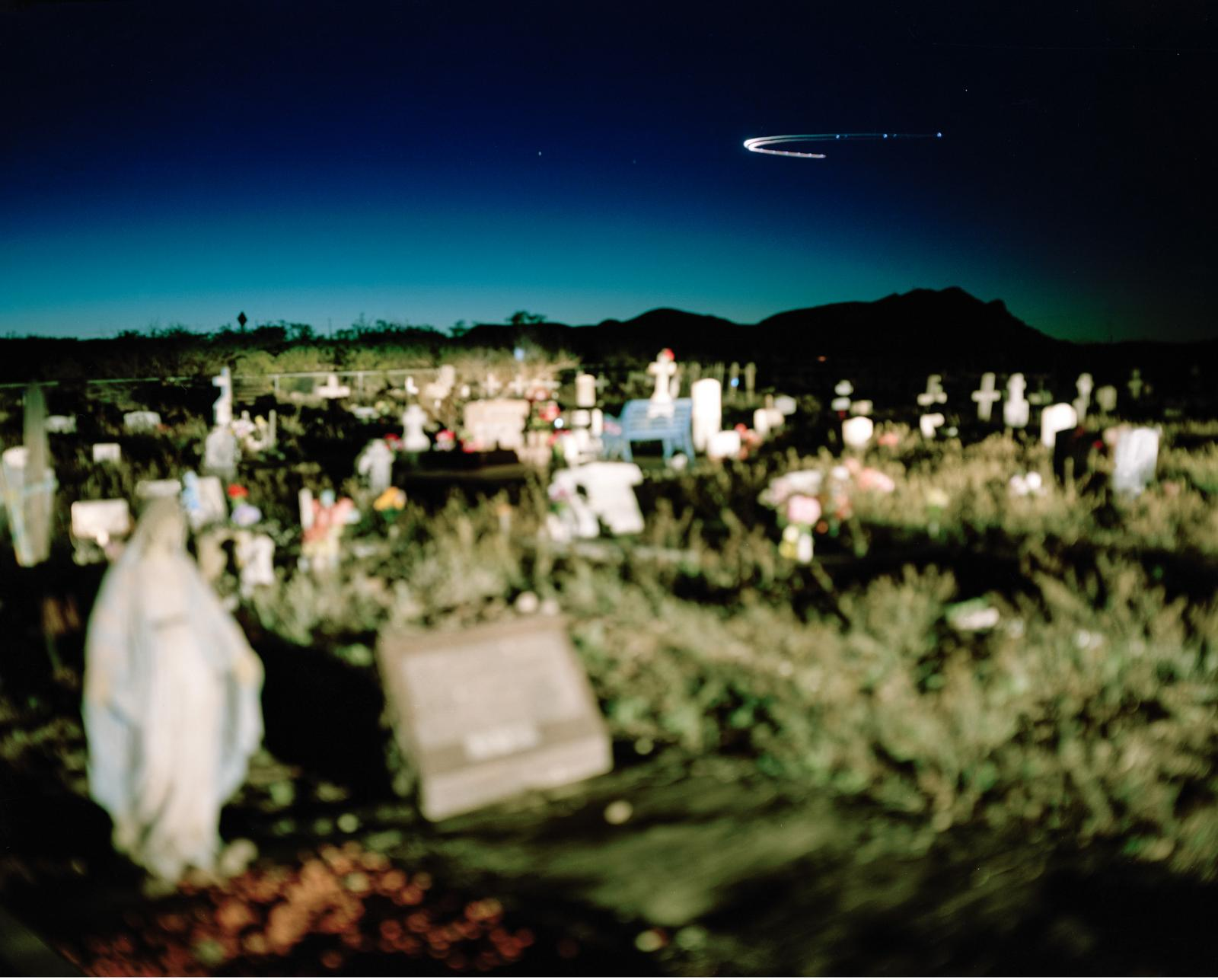 Luis Lopez Cemetery, New Mexico, USA, April 2, 2016  Luis Lopez is a town in one of four counties being studied for health impacts resulting from radiation fallout from the 1945 Trinity Atomic test. Unlike residents of Nevada and Utah, those in New Mexico have never been acknowledged or covered under the Radiation Exposure Compensation Act.  Luis Lopez residents say dozens of people in the cemetery died of cancer and wonder if it is linked to the Trinity test. Residents within 150 miles of the Trinity site show higher incidents of cancer than in other parts of New Mexico according to a health impact study released in 2017 by the Tularosa Basin Downwinders Consortium.