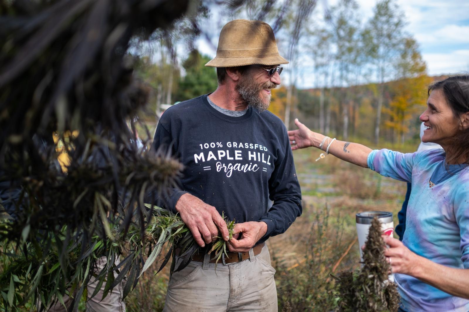 A festivalgoer thanks George Knarich for growing hemp on his 20-acre farm and allowing them to help him harvest.