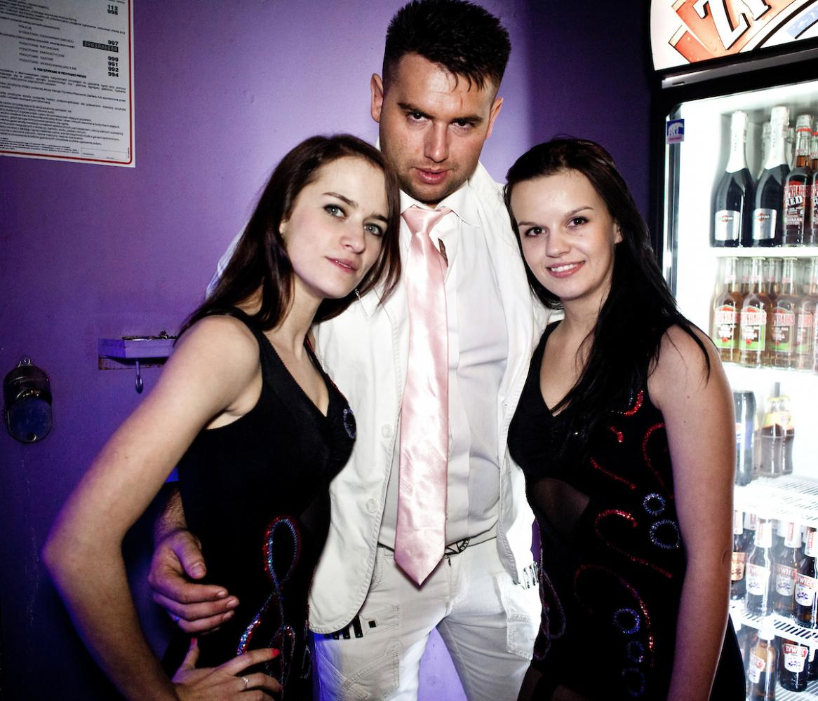 WARSAW, POLAND, JANUARY 2013: Sandra Tworkowska, Edyta Pienkowska, Kamil Chludzinski - Performers of EXTAZY, a disco polo band, posing before their concert at the Freedom club. Disco polo is a type of dance music which originated in rural areas of Poland. Though considered tacky by many people, it is becoming incredibly popular (Photo by Piotr Malecki / Napo Images) Warszawa, styczen 2013: Zespol disco polo EXTAZY pozuje w klubie Freedom. Sandra Tworkowska, Edyta Pienkowska, Kamil Chludzinski. Fot: Piotr Malecki / Napo Images