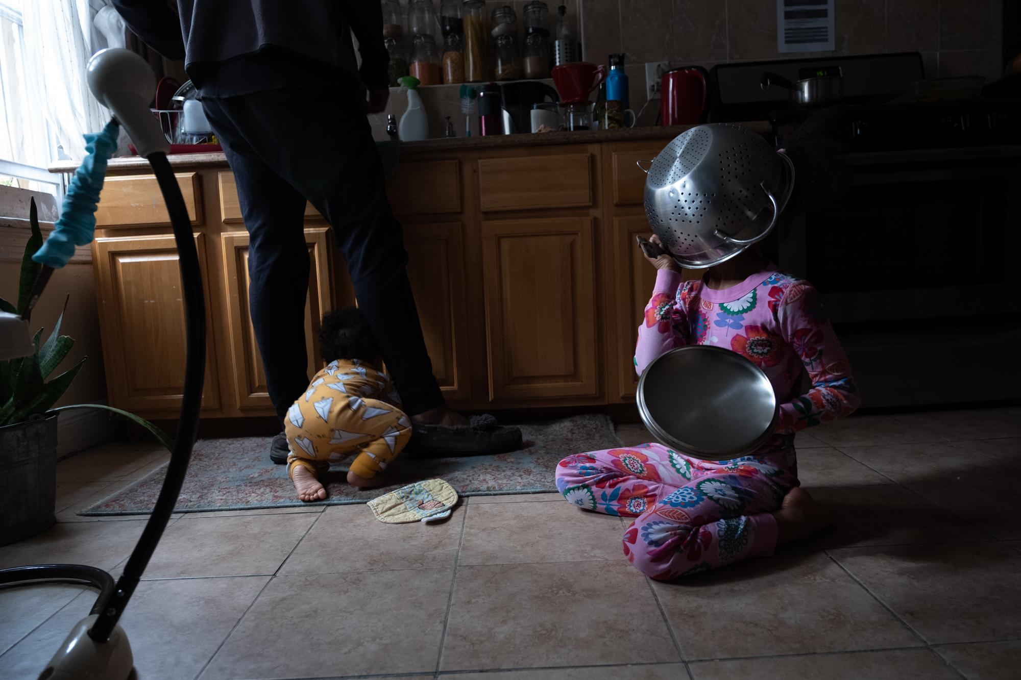 April 7, 2020: The children amuse themselves while Thierry does the dishes. I drink coffee and think about the social impact of the virus flattening so many people physically, emotionally, financially.