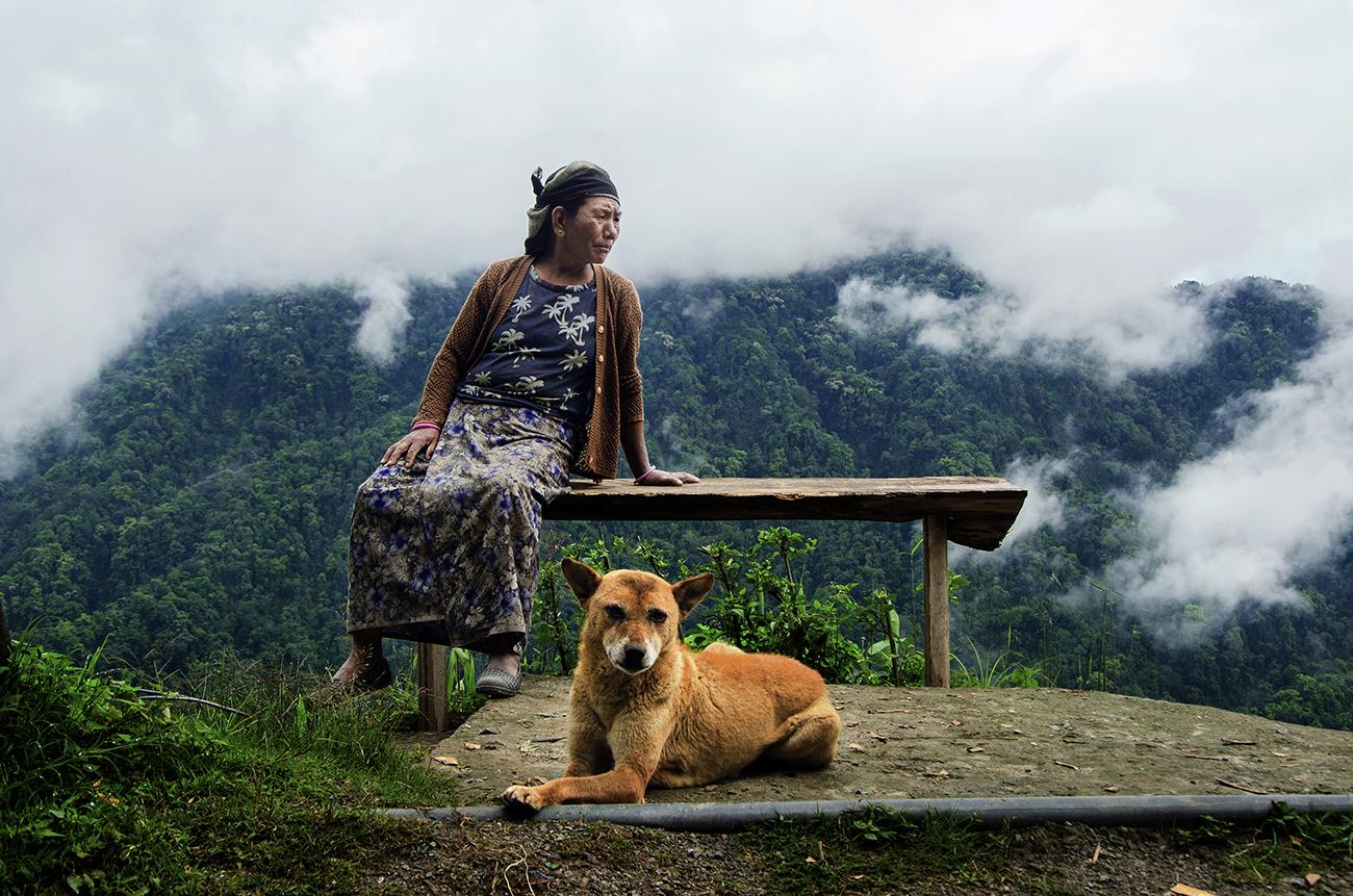 Portrait of a Gorkha Lady and her pet in Rikisum, West Bengal.