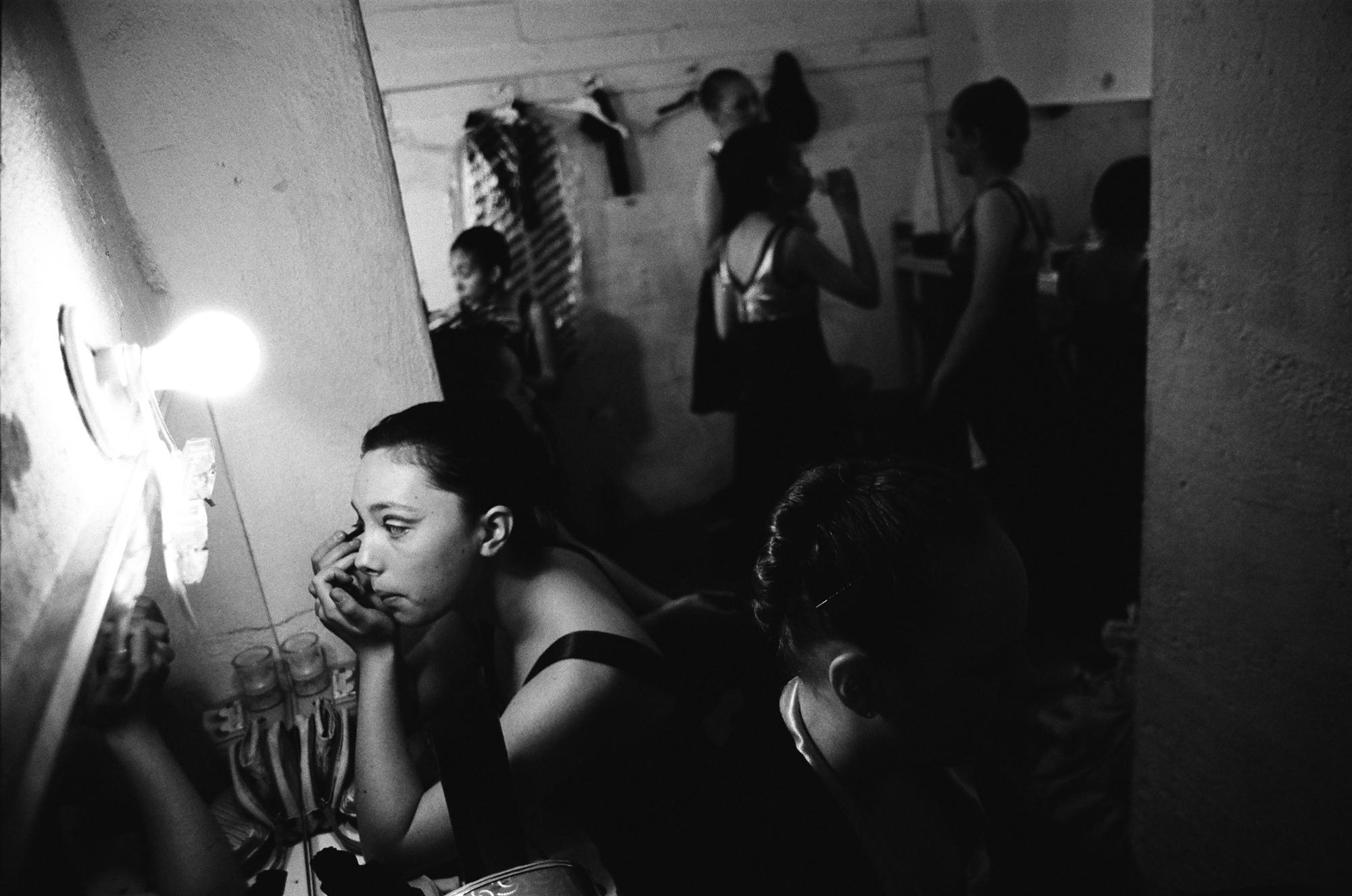 """Young dancers of the Alameda Civic Ballet prepare in the dressing room for a performance in the Kofman Theatre as part of """"United We Dance,"""" an event that ACB hosted to bring ten troupes together from the San Francisco Bay area."""