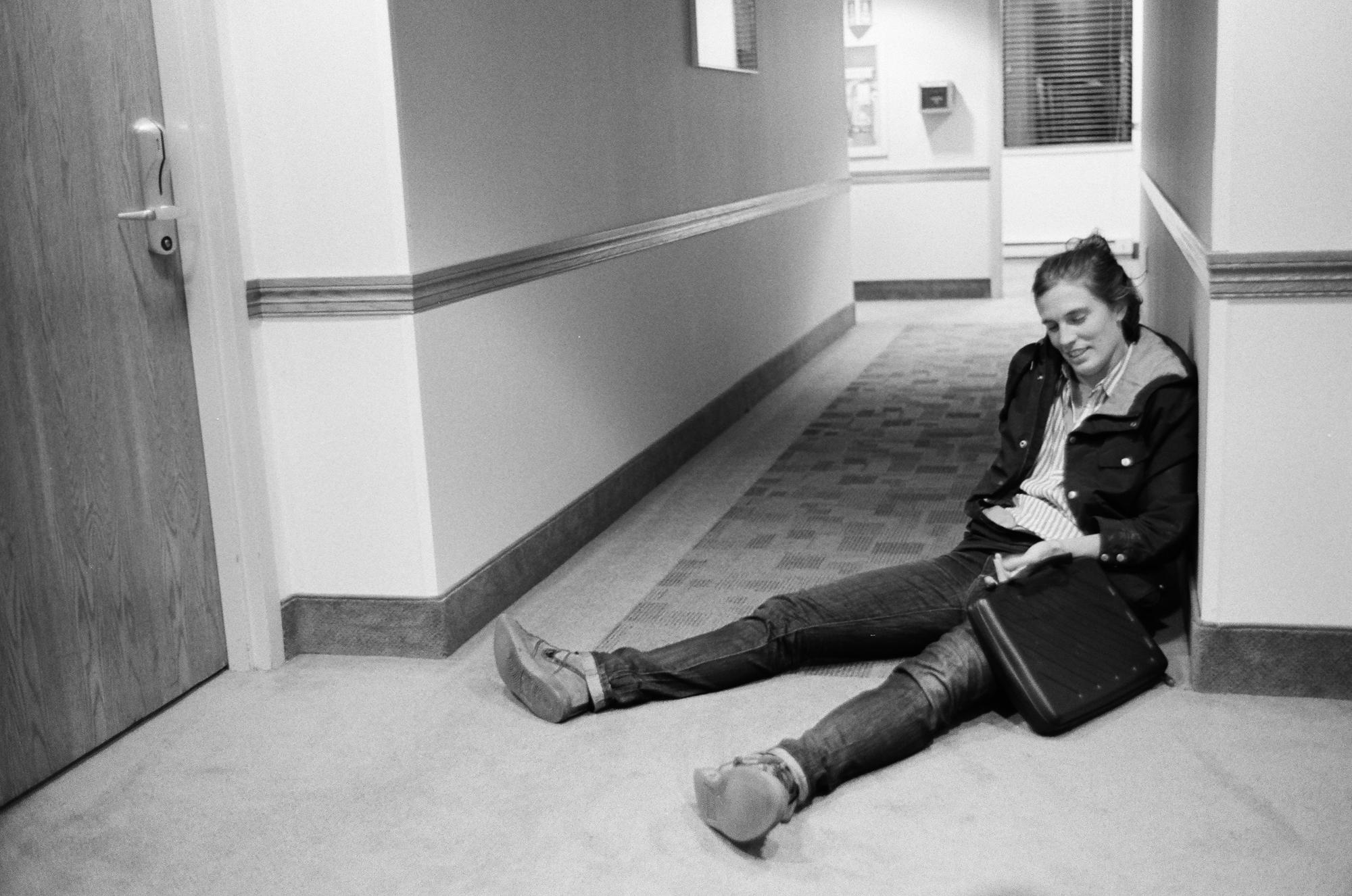 """Journalist Sara LaFleur-Vetter sits exhausted outside her hotel room awaiting a new door key at the Prairie Nights Casino in Fort Yates, North Dakota after a long day covering the indigenous led fight against the Dakota Access Pipeline in 2016. SLV is Director and Director of Photography of the feature documentary film """"The Sacred and The Snake,"""" alongside team members Jonathan Klett, Romin Lee Johnson, Tracy Rector, Jean Kawahara and Jordan Marie Brings Three White Horses Daniel. Their own words are below. """"The Sacred & The Snake focuses on how the experience of collective trauma, cultural self-discovery, and non-violent direct action catalyzed an array of other resistance movements across the country. While much of the public accepts the media narrative that Standing Rock was a failure, these protagonists defiantly show otherwise. The resistance camps lit a fire in each one of them and set them on a new path, while reawakening a global awareness of the environment and Indigenous sovereignty. We are a collaborative filmmaking team - a group of non-Native filmmakers working alongside a prolific group of Indigenous producers and advisors that are holding us accountable as we embark on this process. We are committed to working within the #decolonizedocs movement and guidelines. Everyday we learn more about how we can humble ourselves in this process, amplify Indigenous voices to guide the project, and redistribute our privilege and power in a productive way."""""""