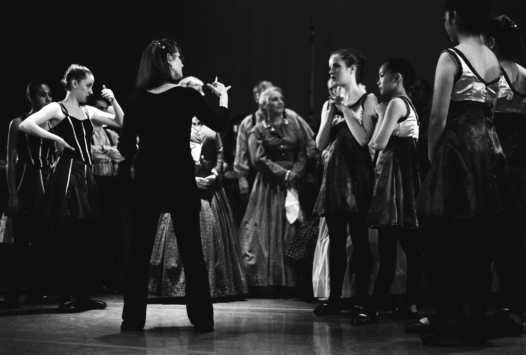 """Abra Rudisil, Creative Director of the Alameda Civic Ballet and retired Principal ballerina of the Oakland Ballet, instructs students at the dress rehearsal of """"United We Dance,"""" at the Kofman Theatre in Alameda, California."""