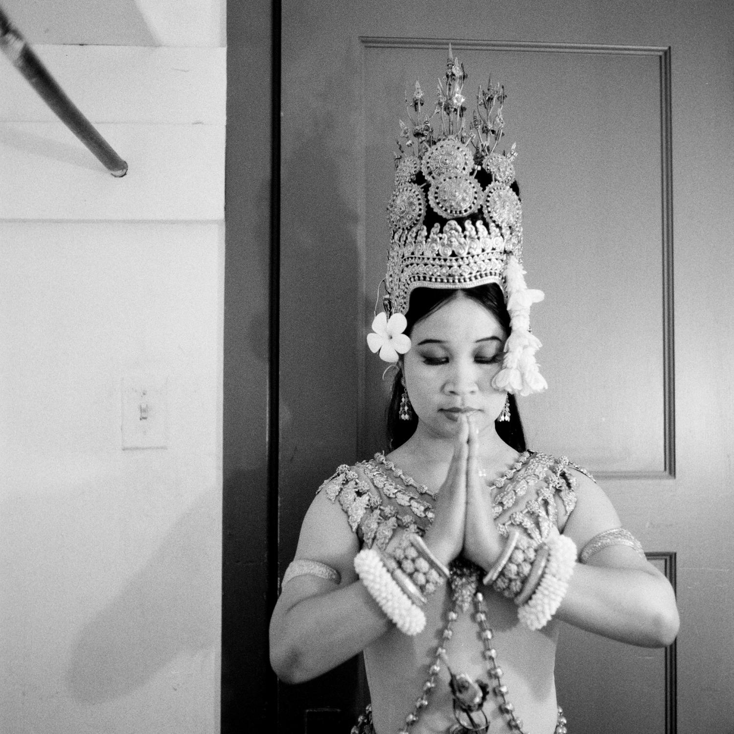 Celebrated dancer Charya Burt meditates in the dressing room, shortly before a performance at Koffman Auditorium in Alameda CA. As a member of Cambodia's Royal Dance Troupe, Charya toured nationally and internationally. After emigrating in 1993, Charya has been performing throughout the United States, including the Getty Museum in Los Angeles, the Kennedy Center in Washington DC, the San Francisco Opera House and countless times as a featured dancer at the San Francisco Ethnic Dance Festival. Her original works have been presented by the Jacob's Pillow Dance Festival, World Arts West, CounterPULSE, UC Santa Barbara, San Francisco Asian Art Museum, Oregon Shakespeare Festival, and many others. Charya holds a B.A., Cum Laude, from Sonoma State University and has conducted dance workshops at schools and colleges around the country. Charya is also a recipient of the Isadora Duncan Award for Individual Performance.