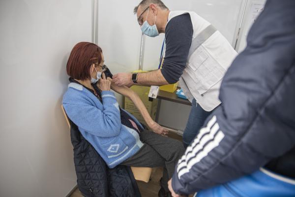A woman being vaccinated against the coronavirus covid 19 by a nurse who injects her first dose of vaccine into her arm, at the vaccinodrome, Stade de France, in Saint-Denis, 93, a suburb next to Paris, on April 7, 2021. Antoine Wdo / Hans Lucas Une dame agee, vieille femme, se faisant vacciner contre la covid 19, coronavirus, par un pompiers pompier de Paris, qui lui injecte sa premiere dose de vaccin dans le bras, au vaccinodrome, du Stade de France, a Saint-Denis, dans le 93, en banlieue a cote de Paris, le 7 avril 2021. Antoine Wdo / Hans Lucas