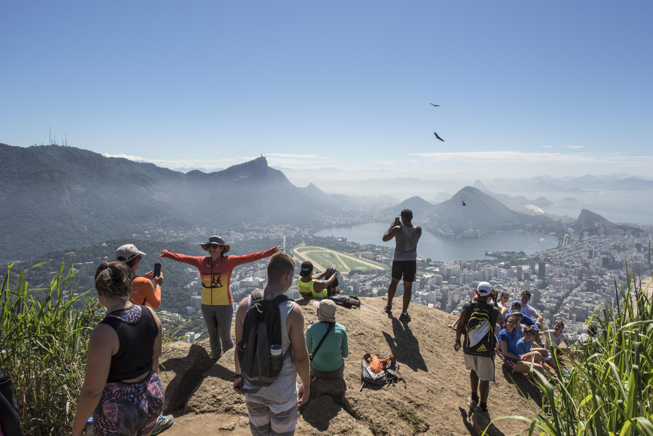Tourists climb up the Dois Irmãos mountains using a hiking trail that has its starting point in Vidigal, a favela in Rio de Janeiro. The trail was off-limits when heavily armed drug gangs ruled the community, but became a popular touristic destination after Vidigal received a so-called Pacification Police Unit, part of a government plan to make the city safer in preparation for the 2016 Olimpic Games