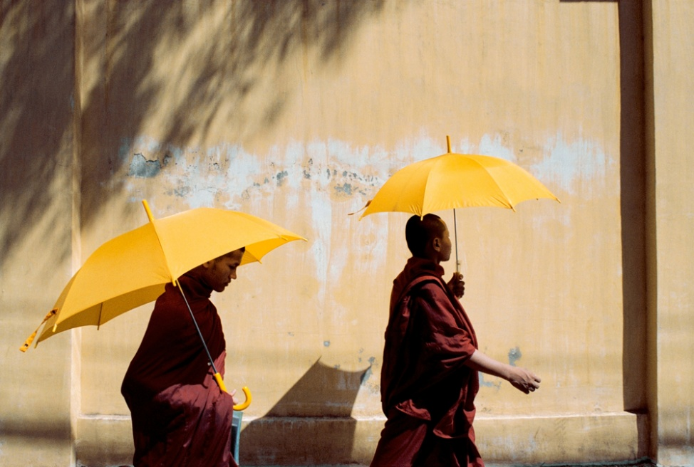 Monks heading for their afternoon studies. Wat Senorom, Phnom Penh, Cambodia.