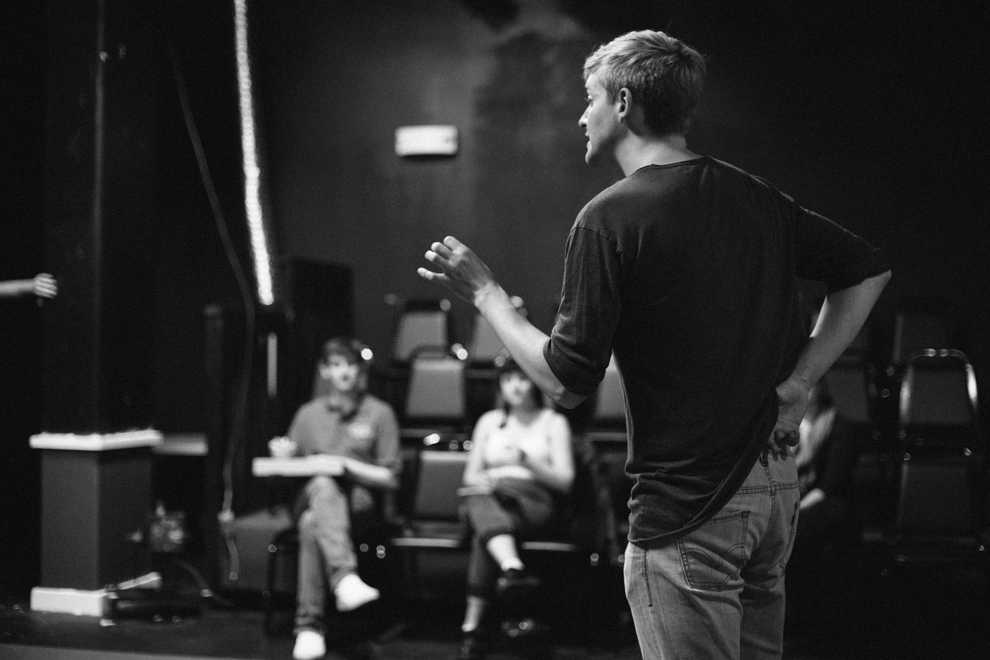 """Director Christopher Chase gives immediate post-performance feedback to the cast of """"I Love You, You're Perfect, Now Change,"""" in San Francisco's Bindlestiff Studio, days before the production run began. The Broadway birthed musical comedy features a limited cast of five, that play multiple characters throughout the show, with breakneck speed wardrobe and set changes happening between scenes constantly throughout the show."""