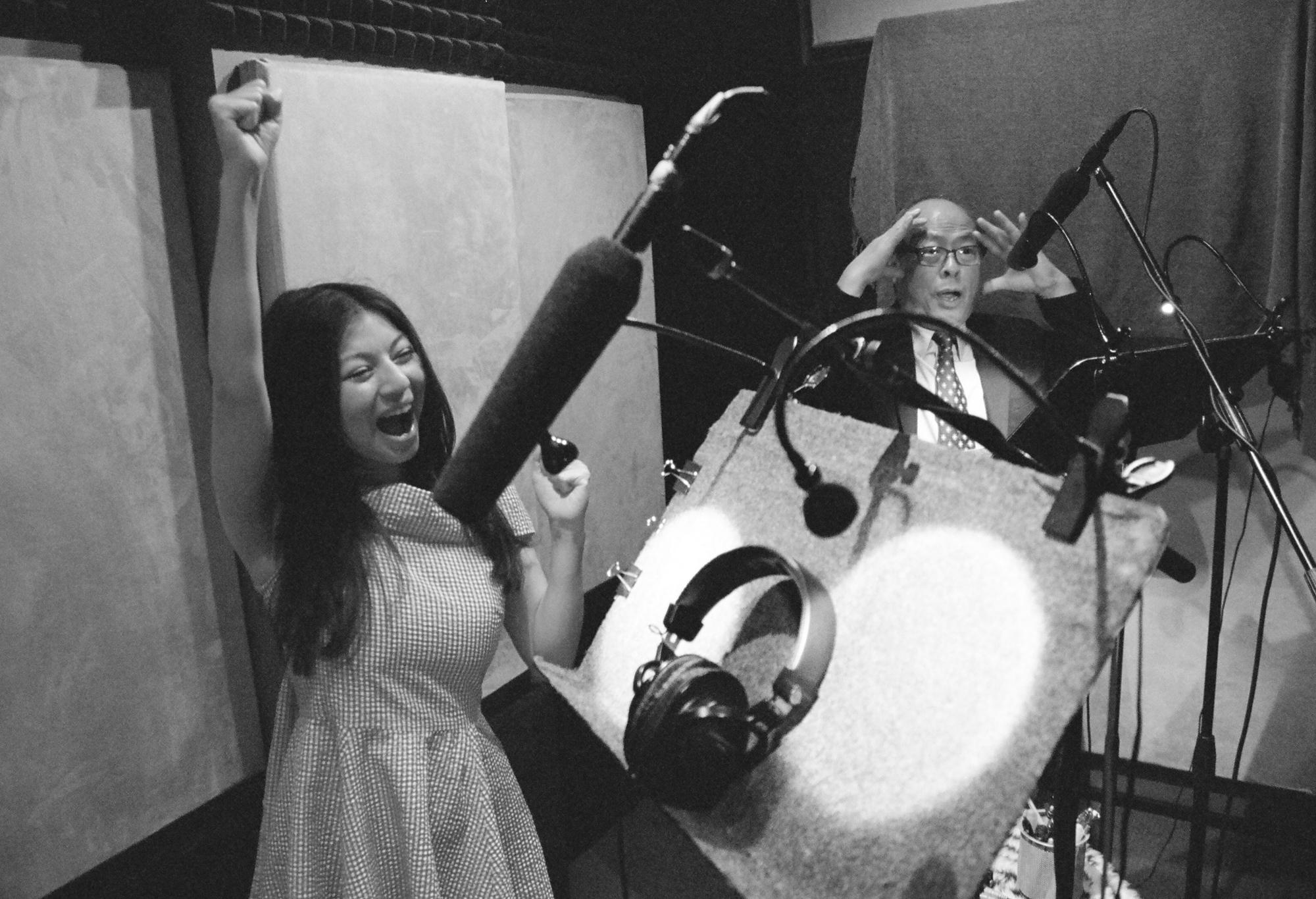 """Actor Katherine Park performs in a sound booth alongside actor Raymond Ma in Studio City, Los Angeles, as voice-over artists for the animated short film """"Up In The Clouds"""" written and directed by Ed Moy. The film focuses on the iconic first Asian American Woman to earn her pilots license in the United States, a trail blazer named Katherine Cheung. She is listed as the first Asian Aviatrix in the United States by the Smithsonian Museum."""
