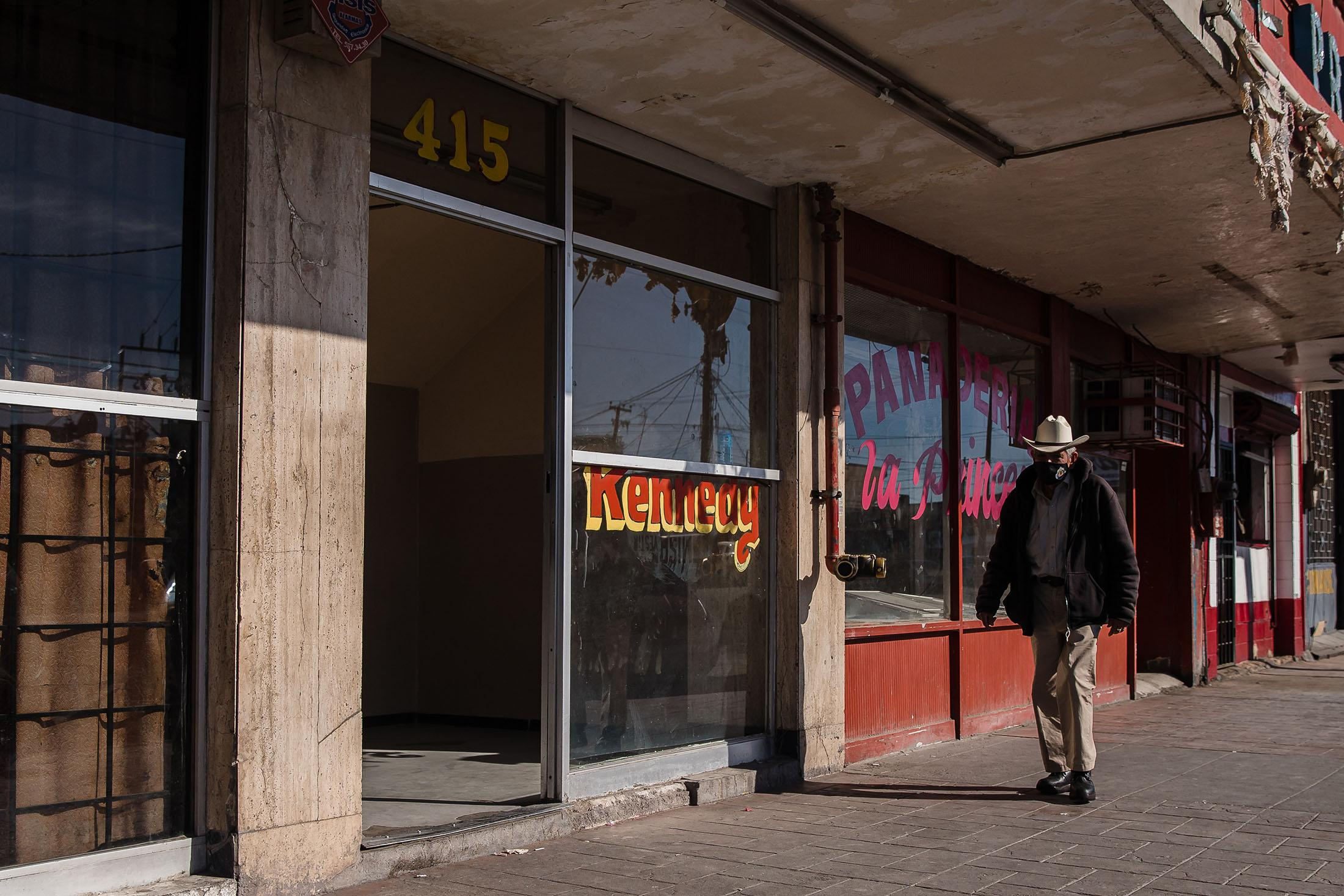 A man walks passed Hotel Kennedy in Mexicali, Mexico. Several of the migrants had been staying at cheap downtown hotels in Mexicali before preparing to cross the border.