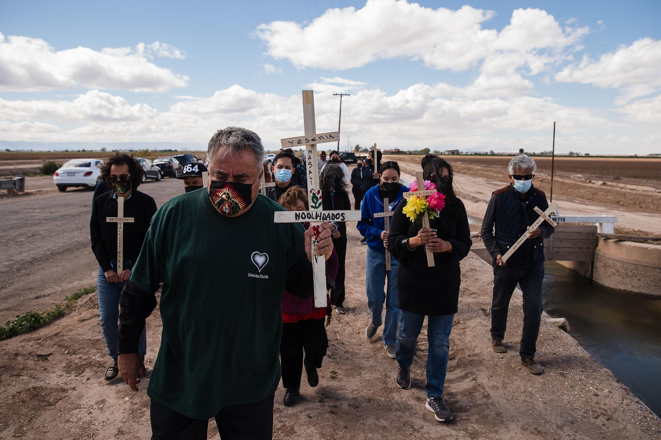 Enrique Morones (center) of Gente Unida leads a group of mourners for the 13 undocumented immigrants who died in early March when an SUV and a tractor-trailer collided near Holtville, California.