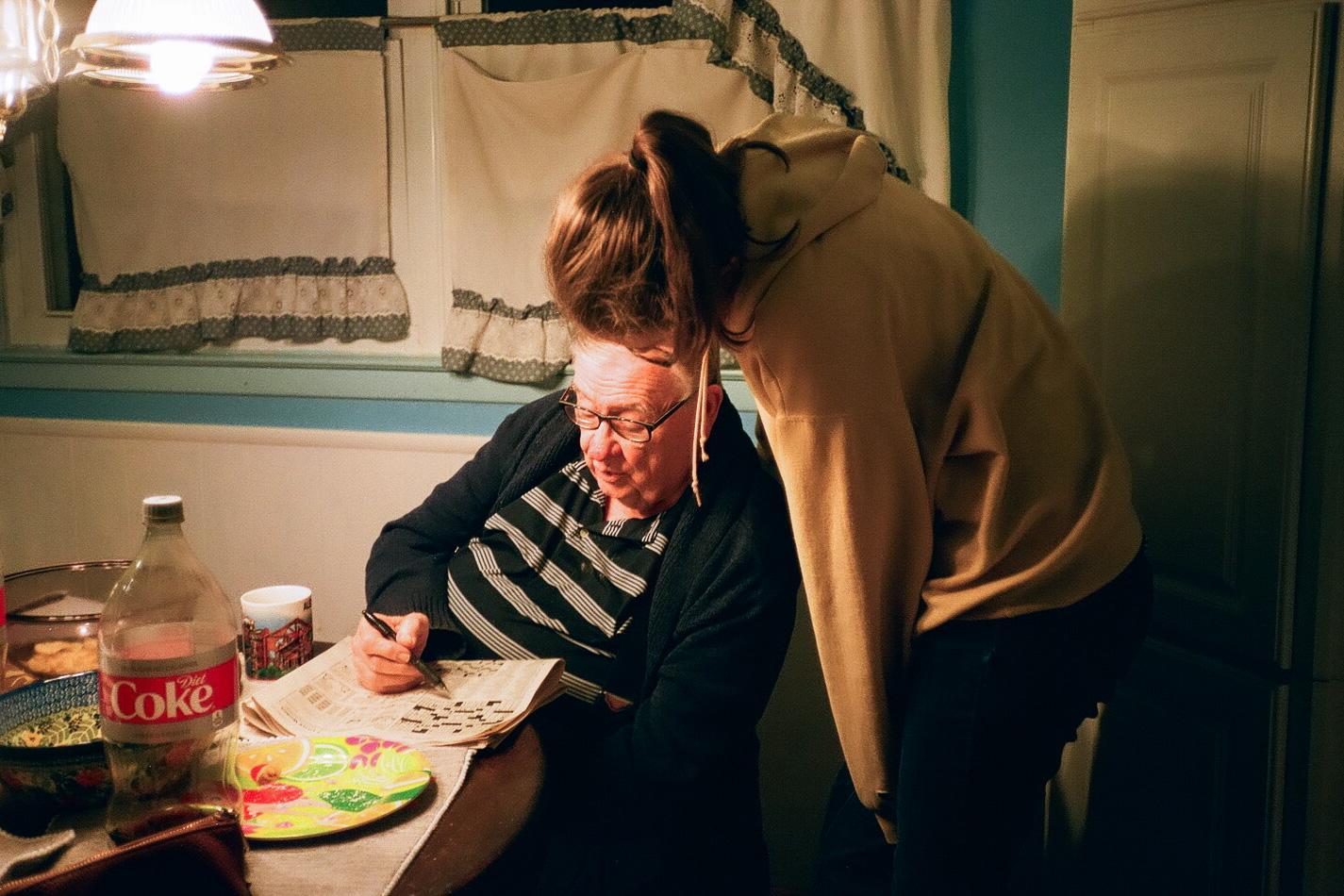 Becca and Grandpa doing a Crossword. Christmas, 2019.