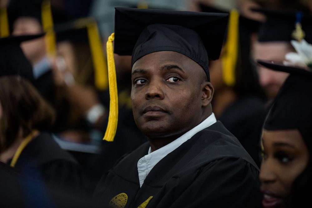 TOWSON, MD - MAY 24, 2019: Maurice Smith, 48, sits among graduates at Goucher College on May 24, 2019. Smith spent 27 years in prison and attended the Goucher Prison Education Partnership to receive his Bachelors degree in American Studies. Rosem Morton for The New York Times