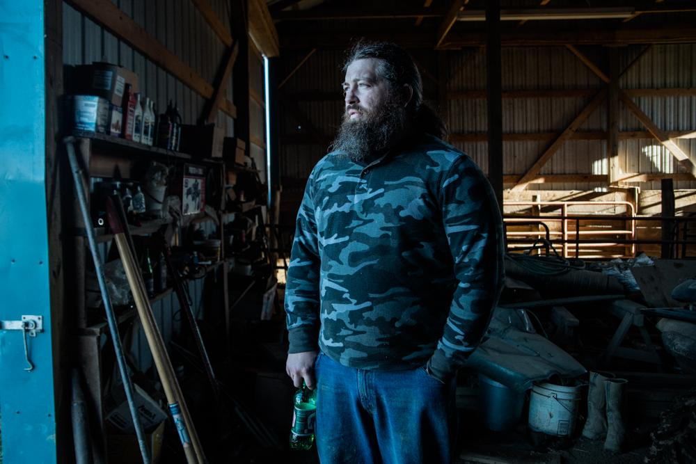 Josh Moore, 36, cuts wood for the winter. The Montgomery County farm, C&J Cattle, has been in the Moore family for several generations.