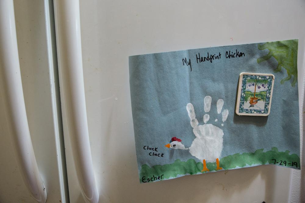 LIVINGSTON MANOR, NY - OCTOBER 13, 2019: A handprint chicken is displayed on the fridge.