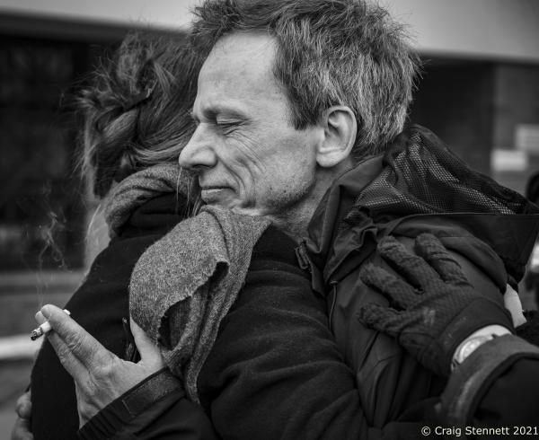 Thorsten Willenbrock co owner of the Kreuzberg bookshop Kisch & Co is consoled in the street outside the court after it gave its verdict.