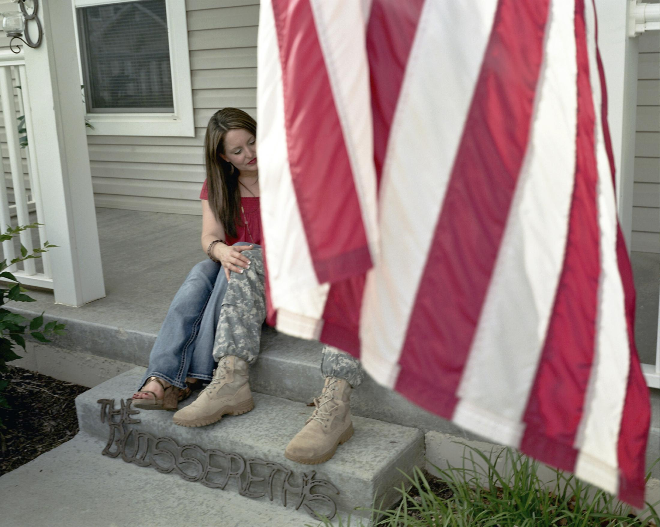 Denise and Andy Buissereth sit on their porch in Fort Leavenworth, Kansas, in 2015 before his deployment.
