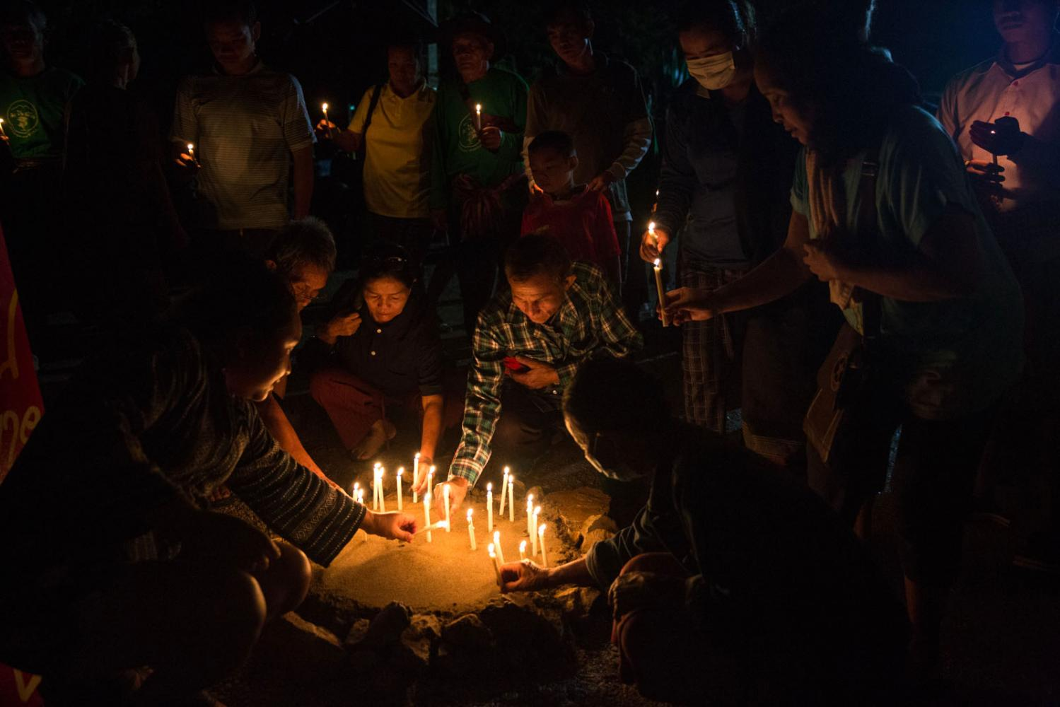 Anti-mining protestors pay tribute to the 4 villagers who have been killed in this prolonged struggle. Nong Bua Lam Phu, Thailand.