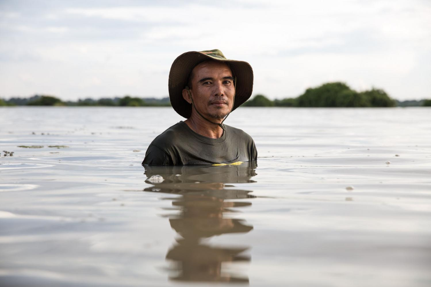 """Apirat Suthawan, 54, is the village chief of Lao Dong village. """"In 29 years the dam has not given us even the smallest bit of water to use!"""" he said. He also saw how the village became split between those for the dam and against and how some of the disagreements still effect relationships today. Rasi Salai, Thailand"""